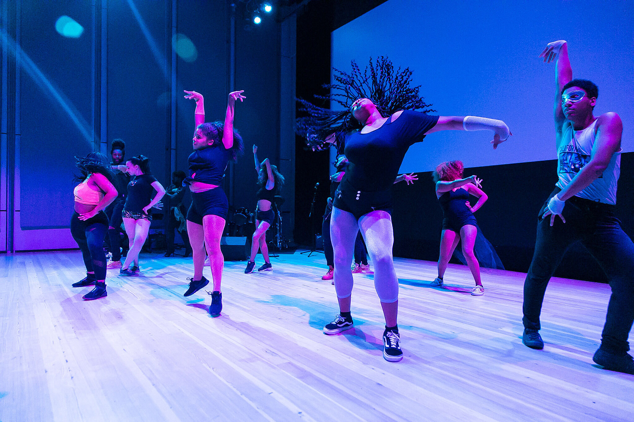 A group of people engaging in a dance performance.