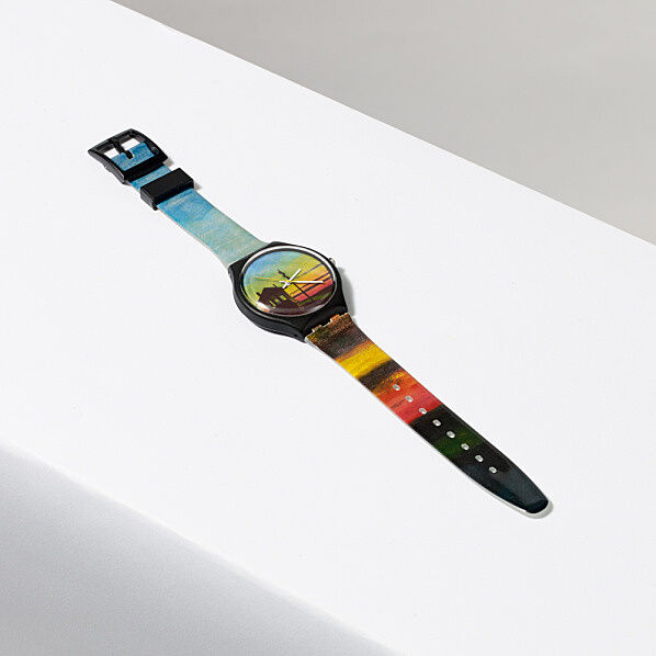 Watch with a painting of a sunset on its face