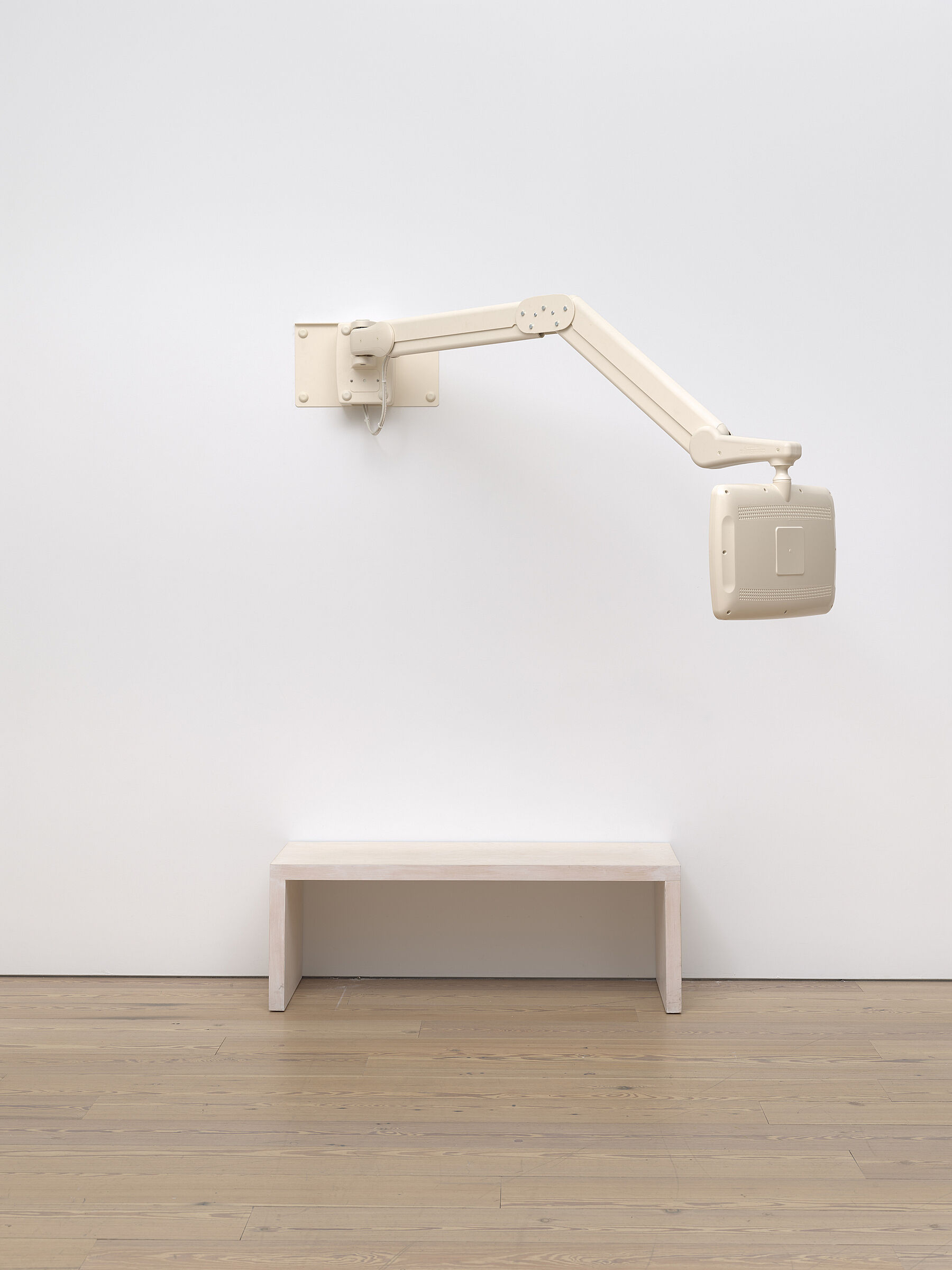 A photograph of a sculpture in a gallery.
