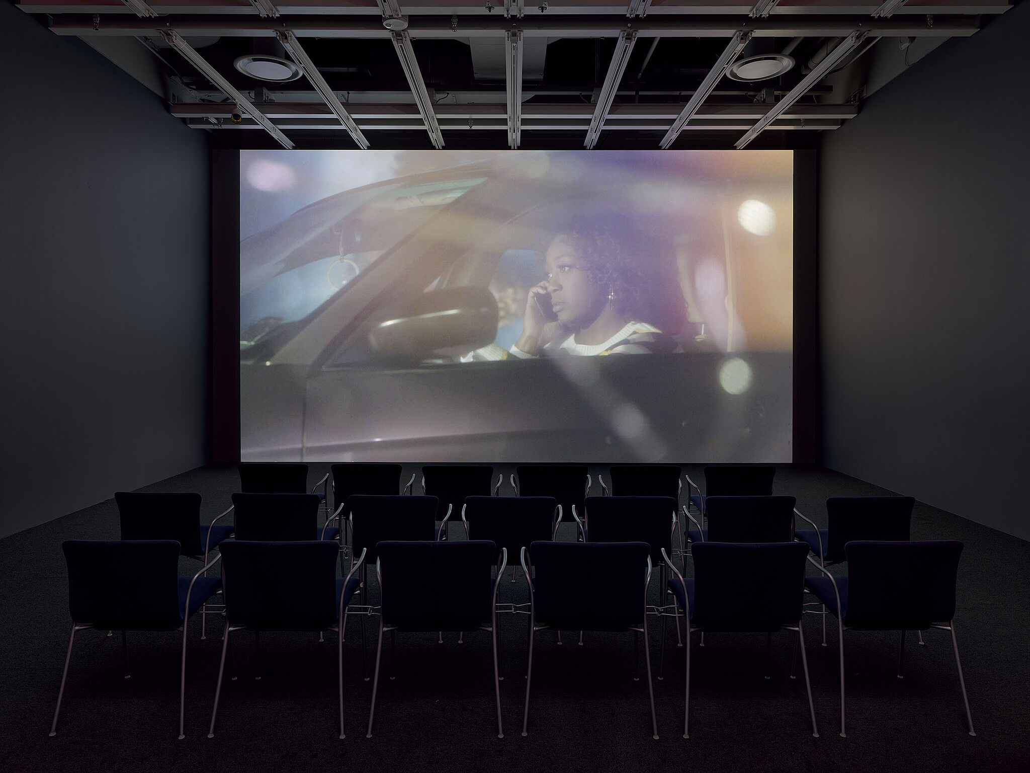 An installation view of a video projection in a gallery.