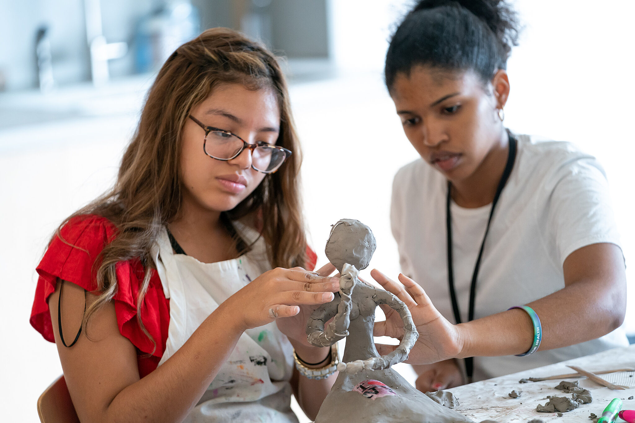 Teens creating a sculpture.