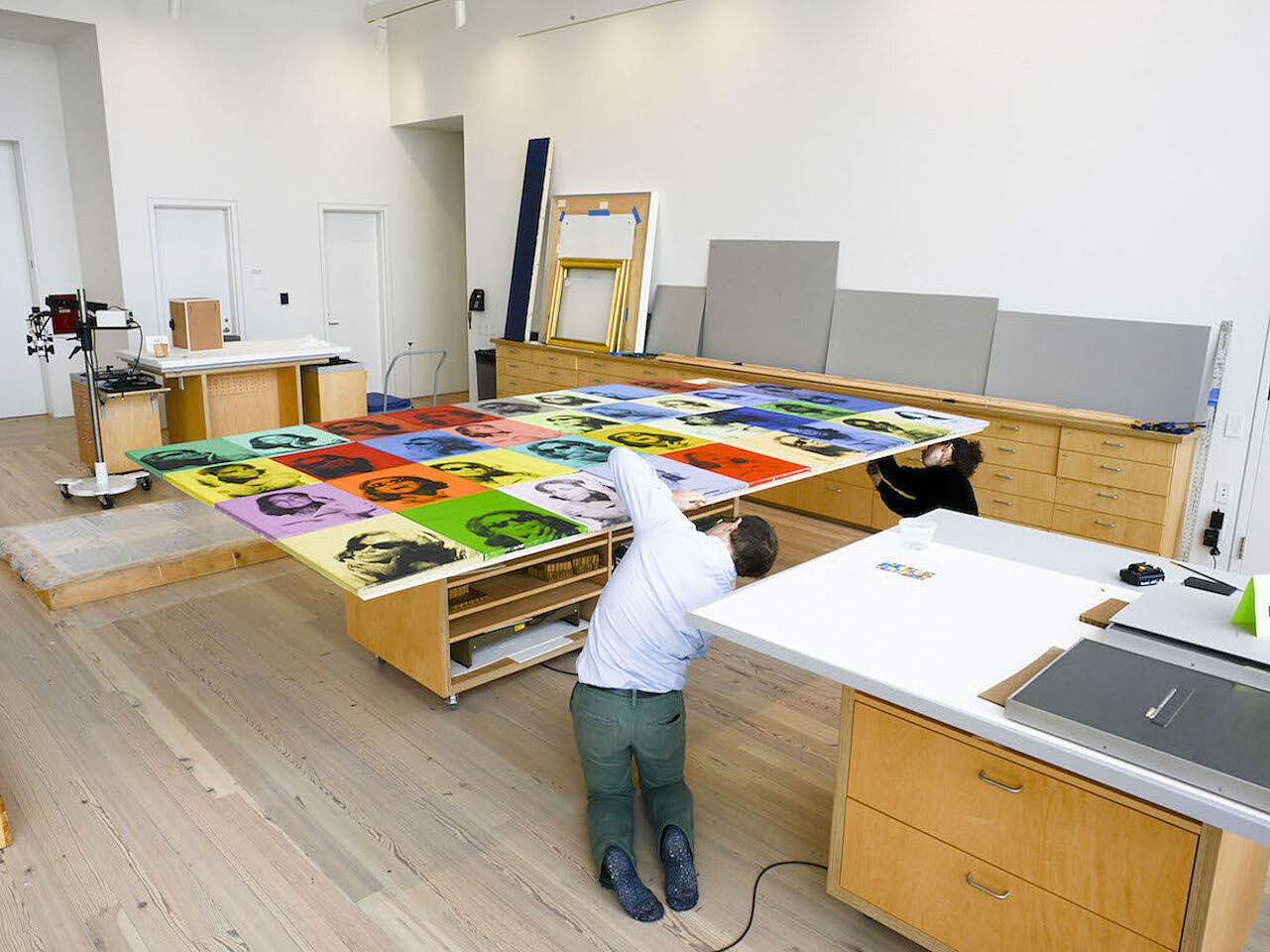 Conservationists working on an artwork by Andy Warhol.