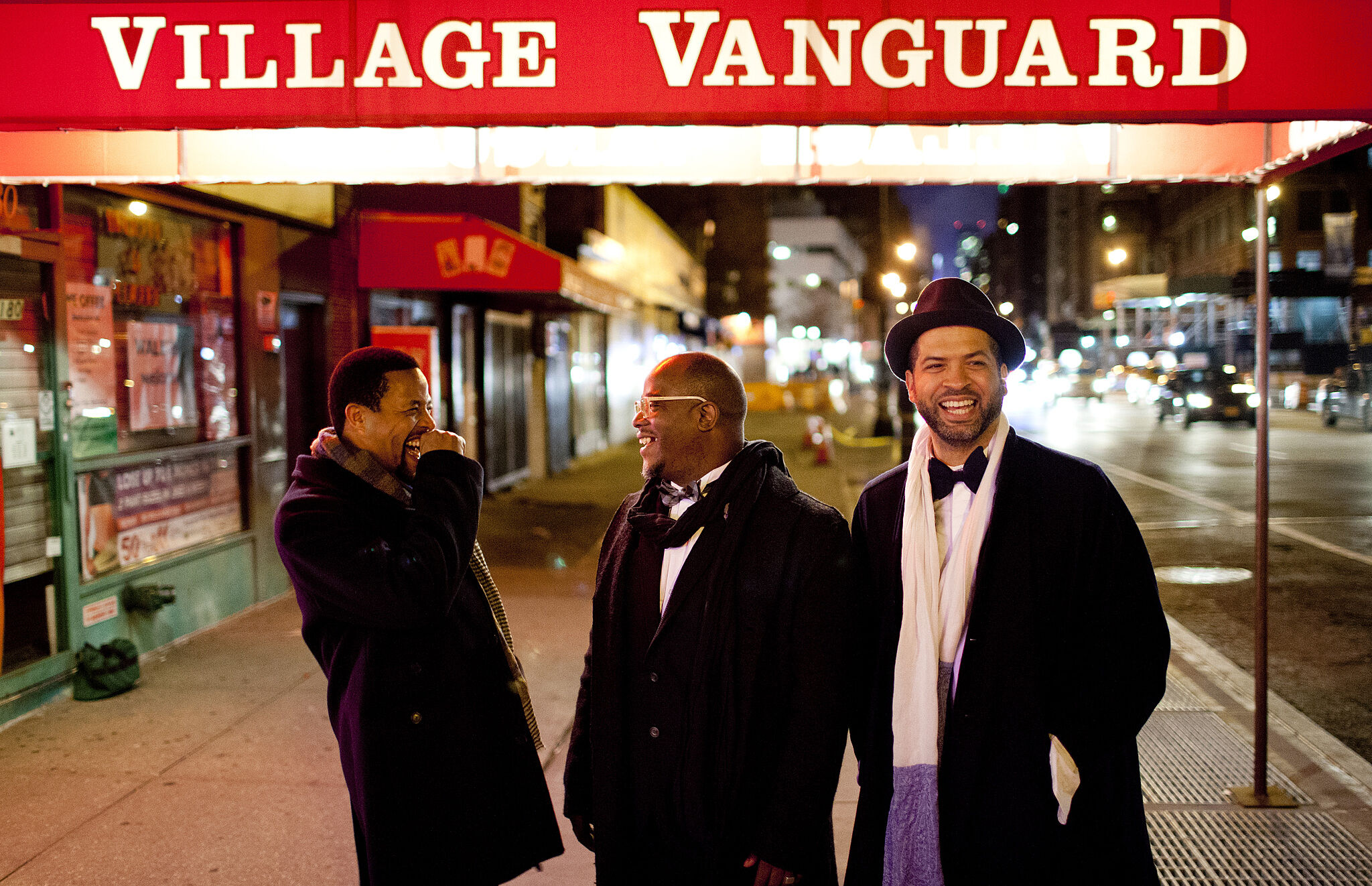 A photo of Nasheet Waits, Tarus Mateen, and Jason Moran outside the Village Vanguard