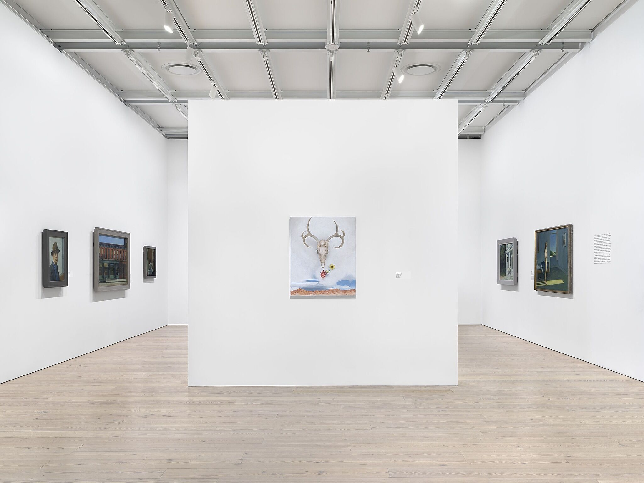An image of the Whitney galleries with paintings