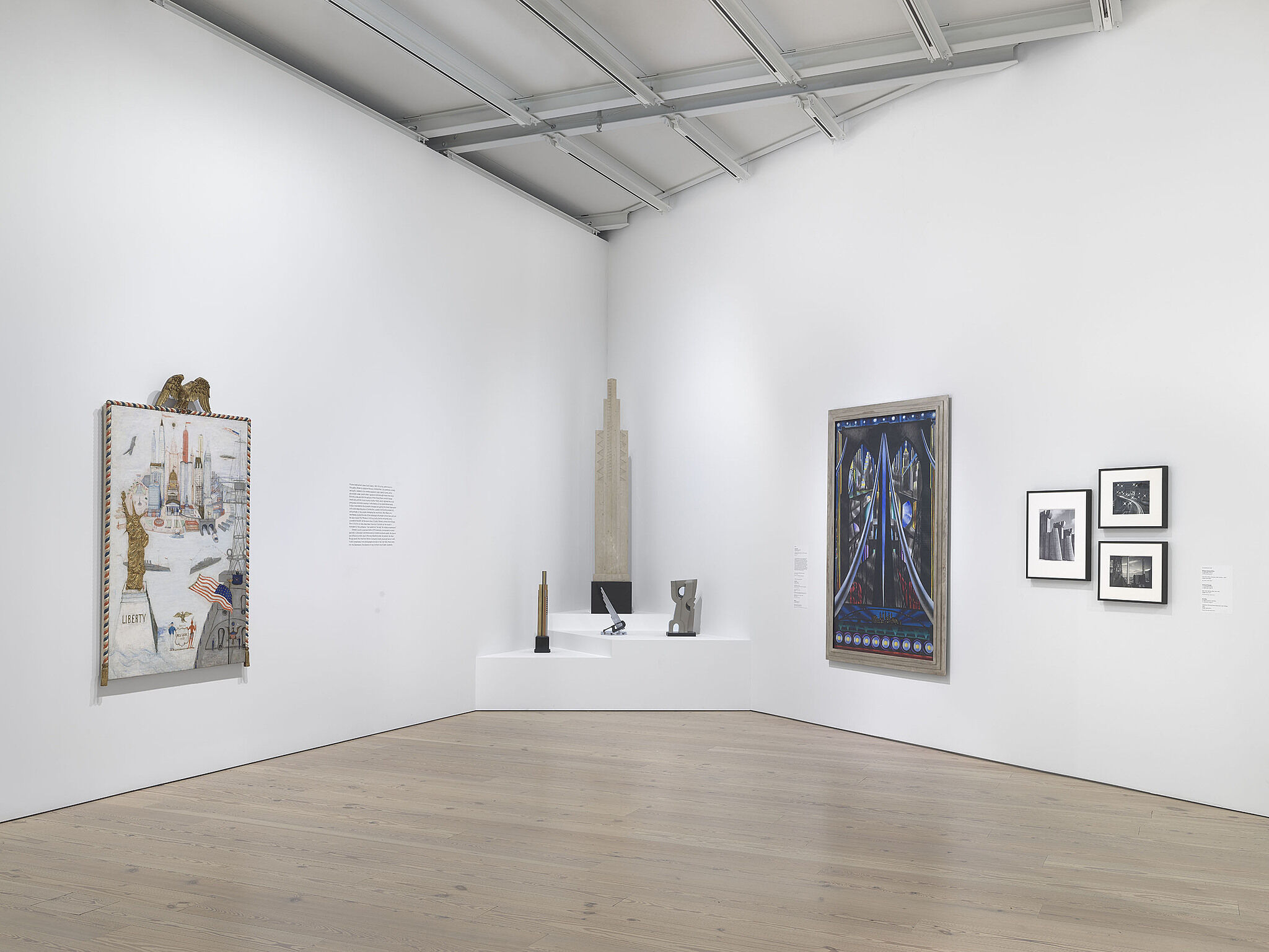 An image of the Whitney galleries with multiple sculptures in the corner