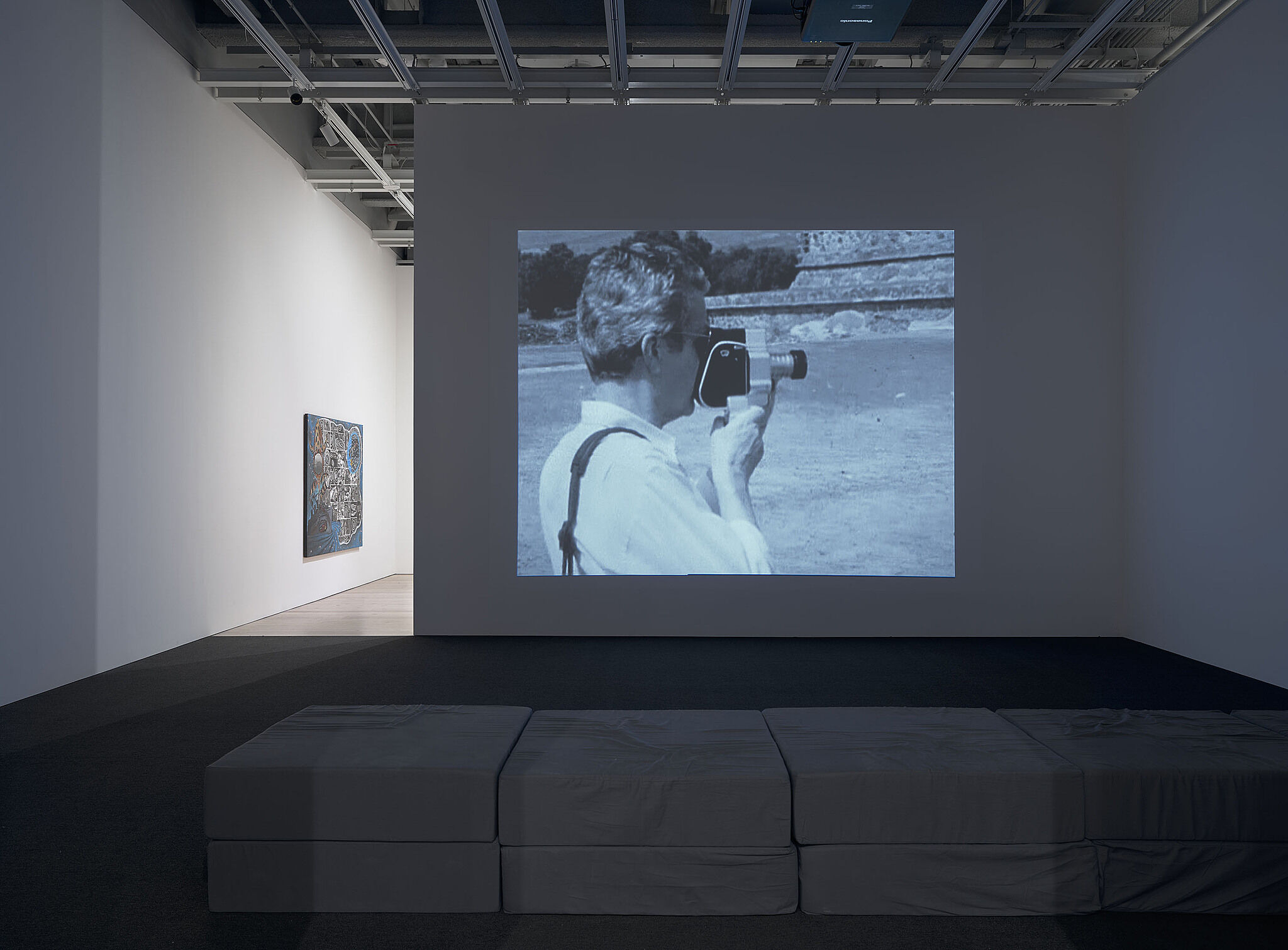 An image of the Whitney galleries with video projections on the walls