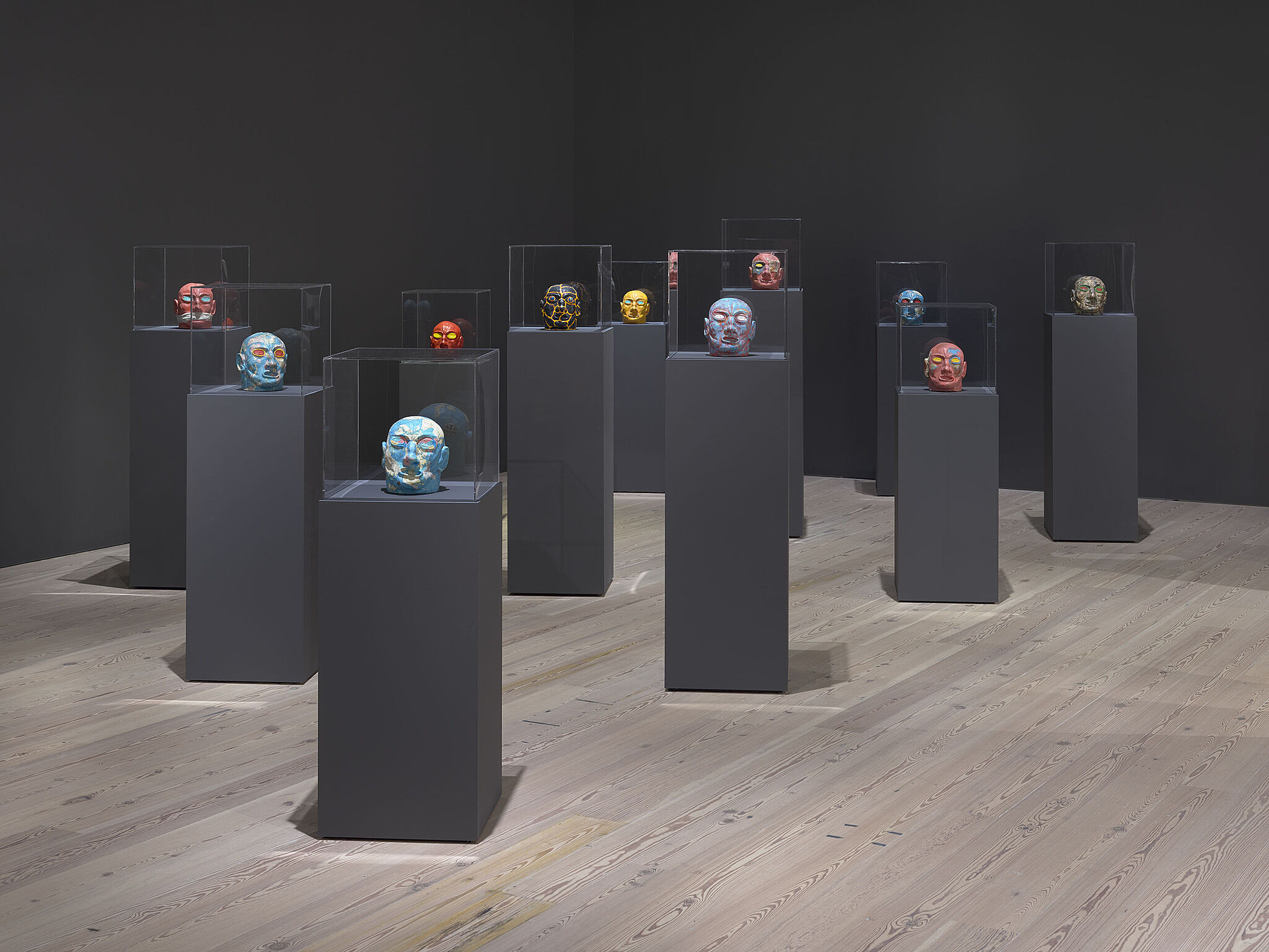 An image of the Whitney galleries with various plinths with artwork
