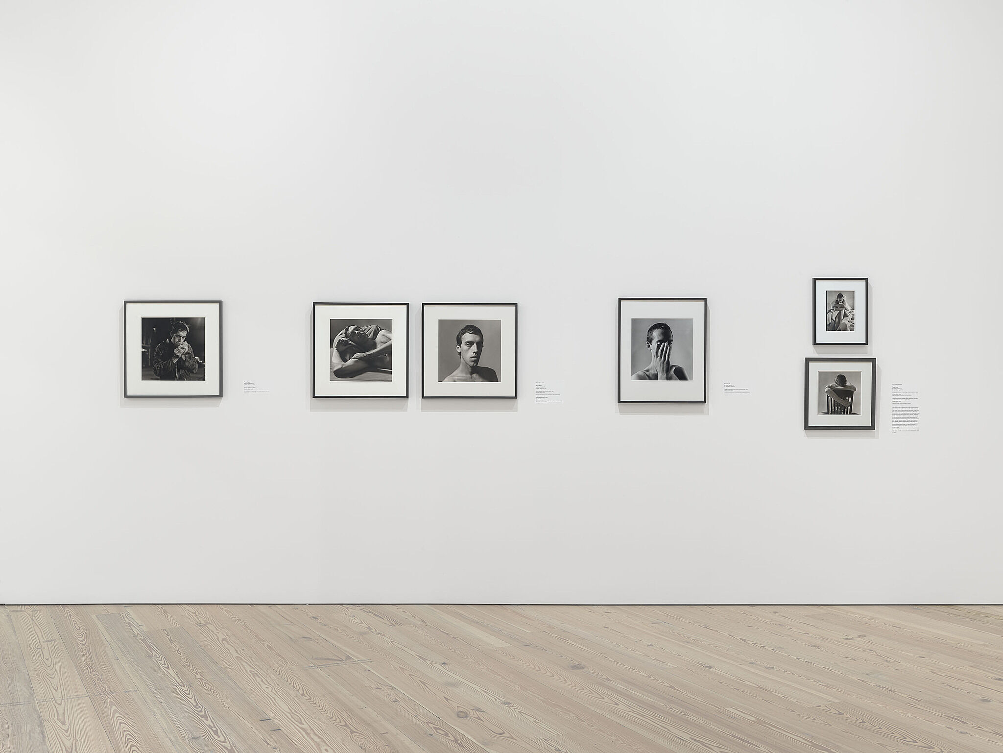 An image of the Whitney galleries with various photographs on the wall