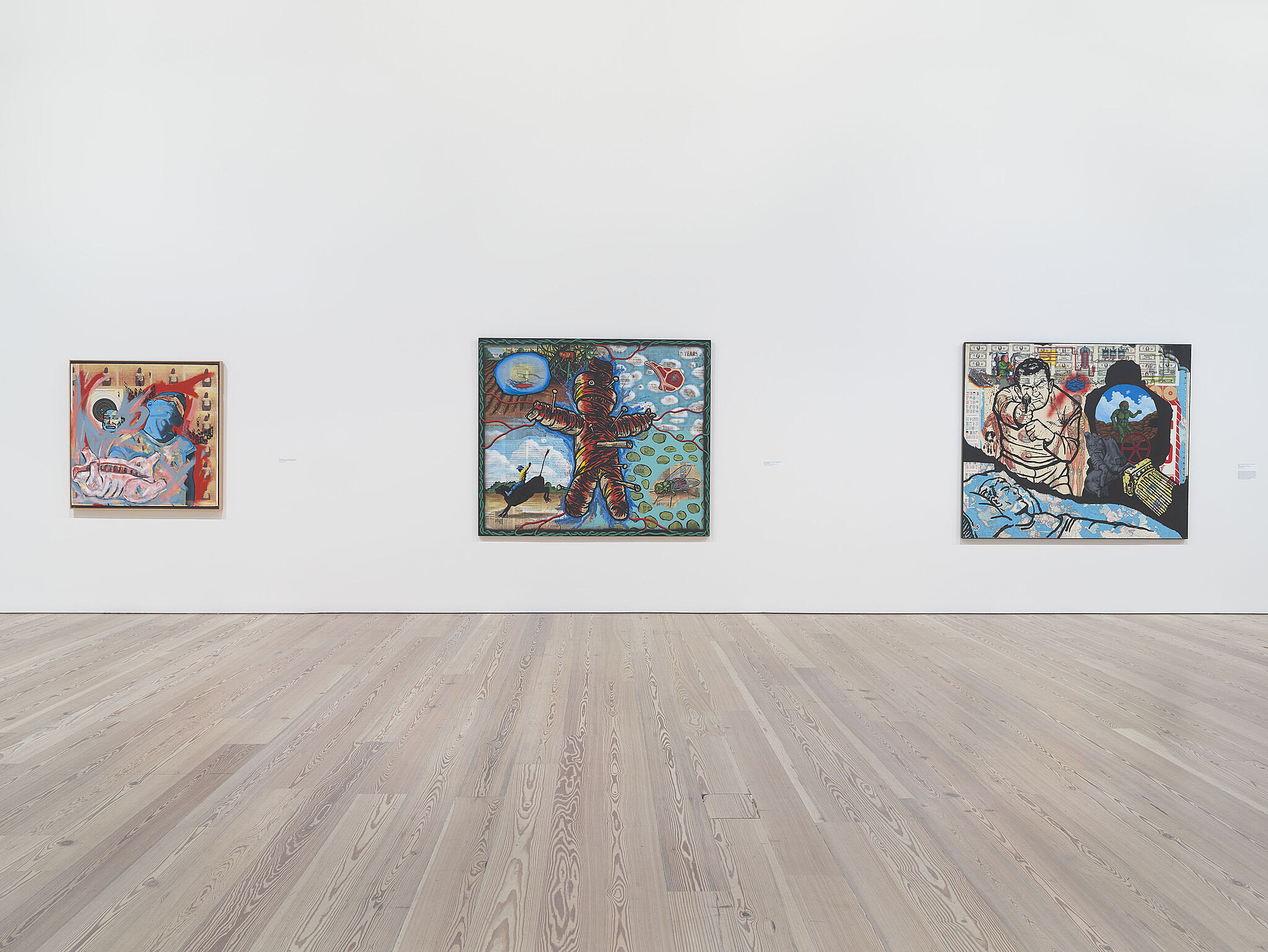 An image of the Whitney galleries with various artworks on the wall