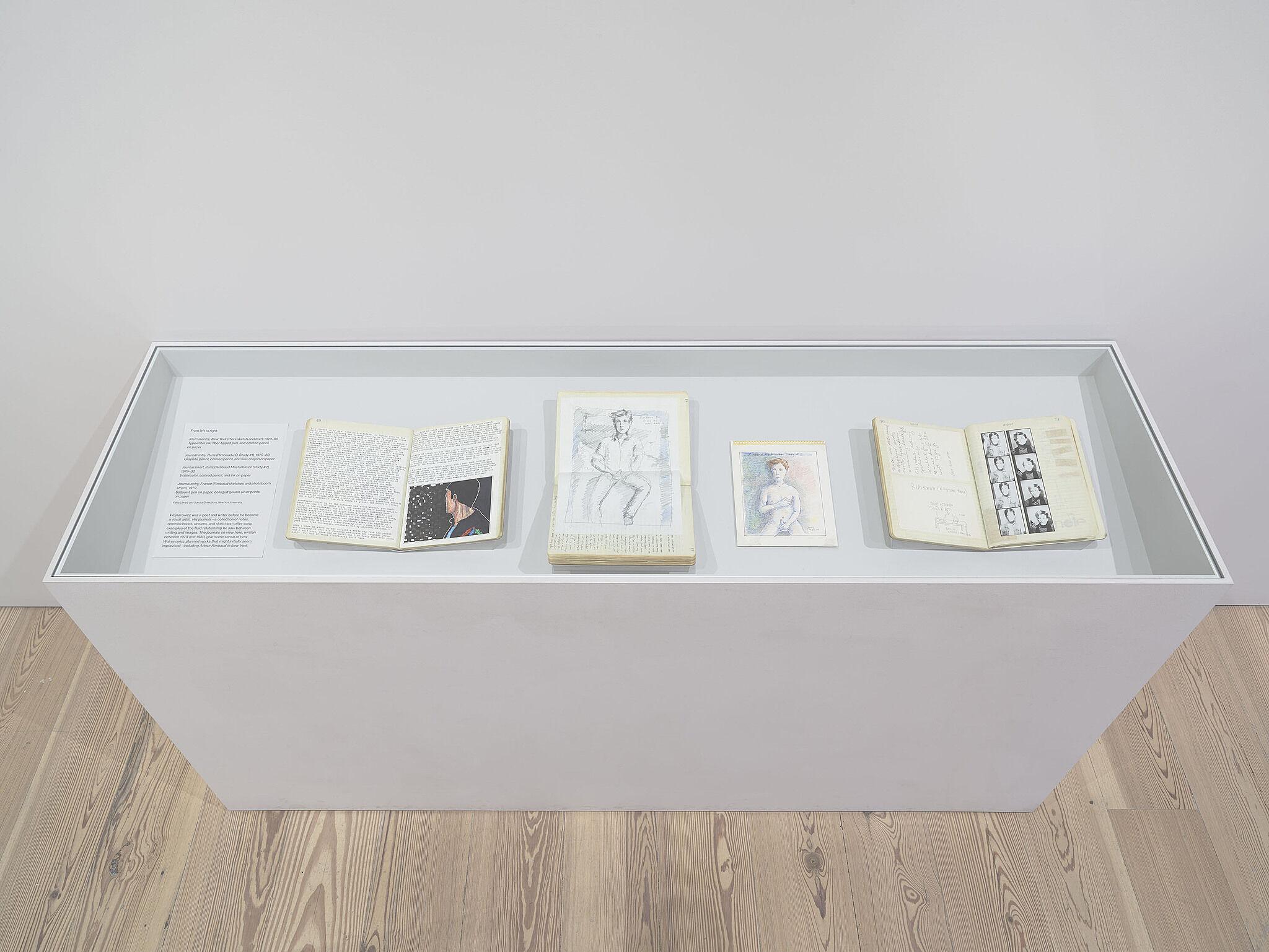 An image of a vitrine with journal pages in it