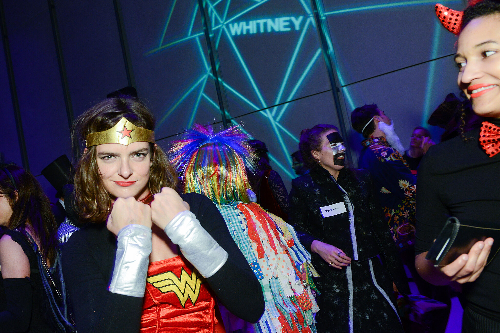 A photo of a person in a Wonder Woman costume at the Whitney.