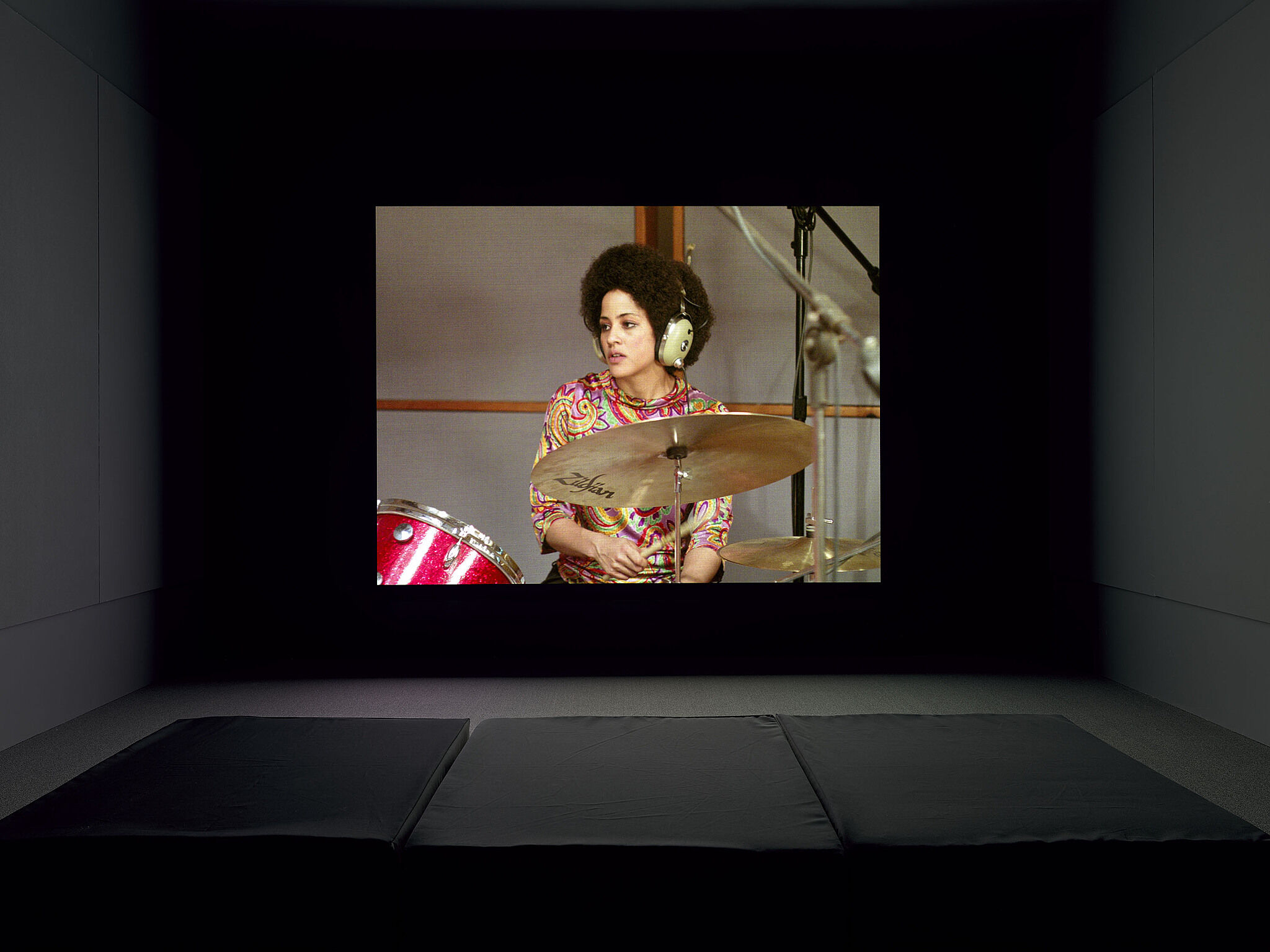 A video projection of a person playing the drums