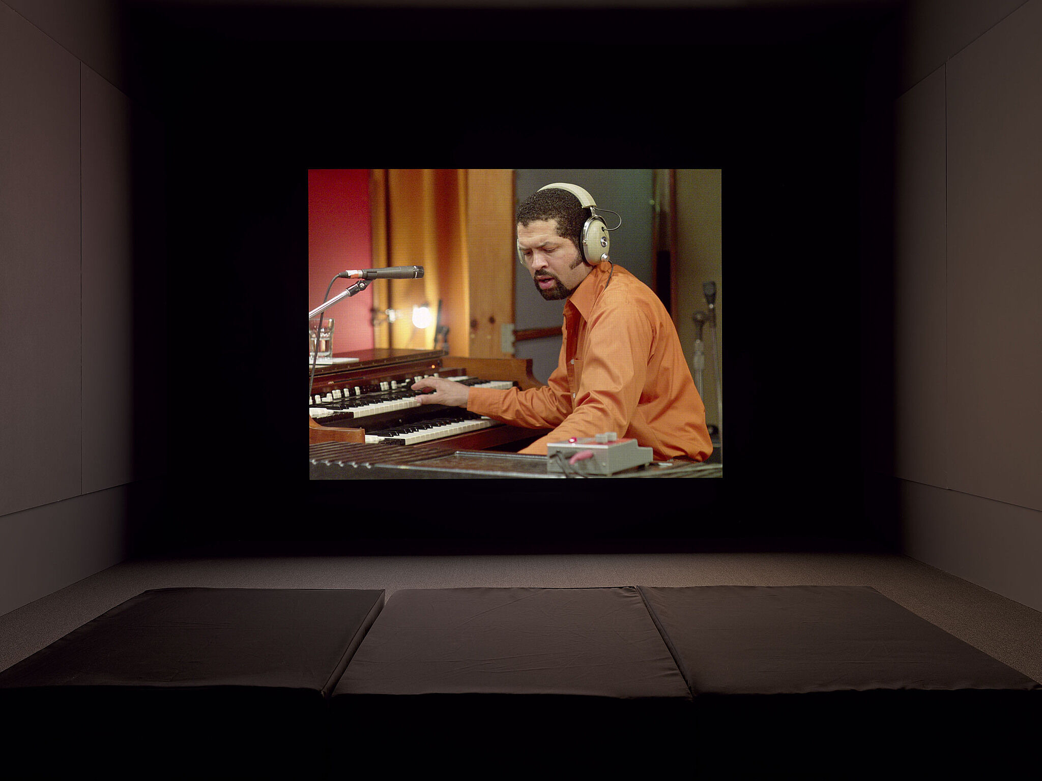 A video projection of a person playing piano