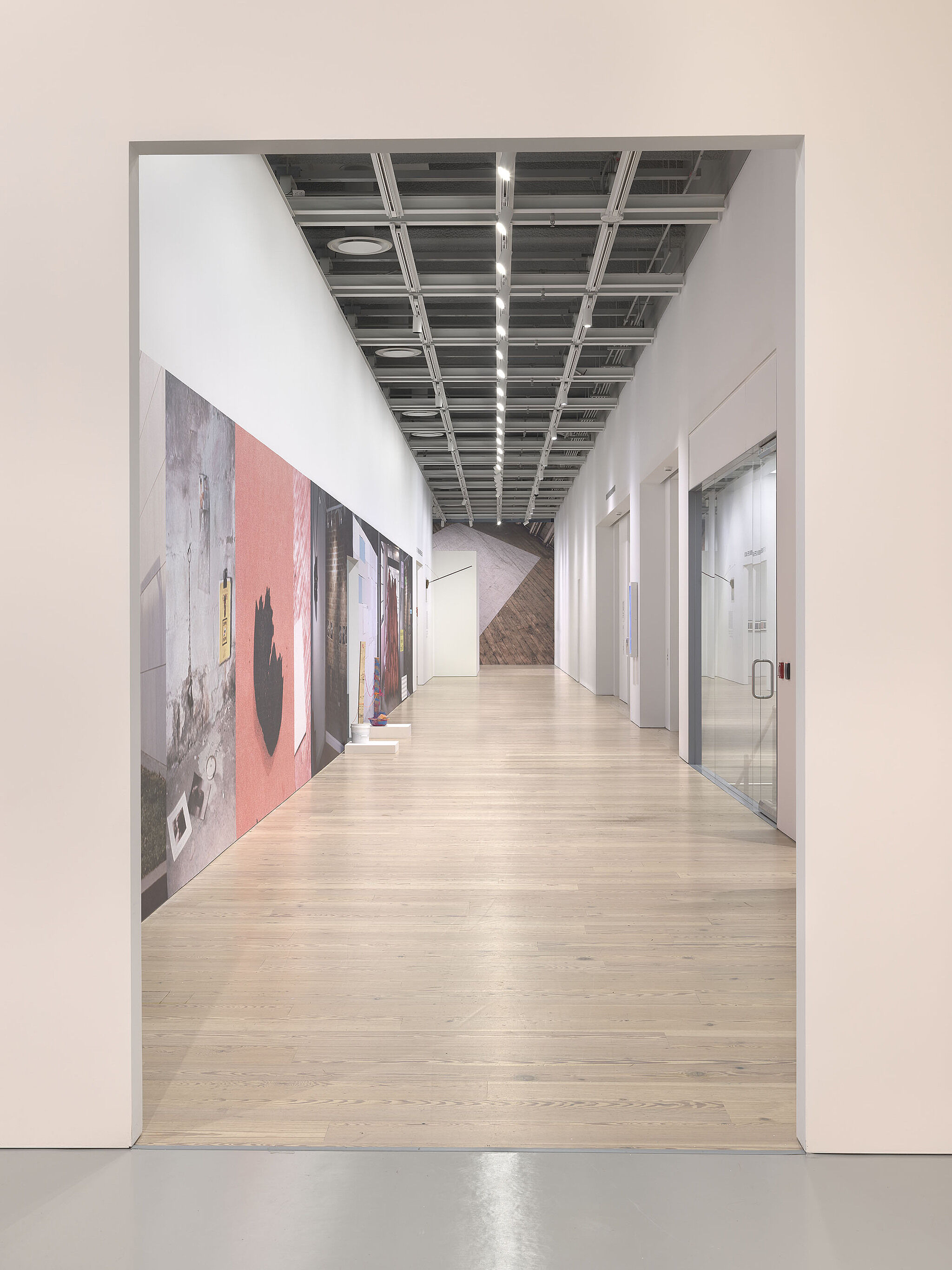 An image of a hallway in the Whitney galleries with various photos on the wall.