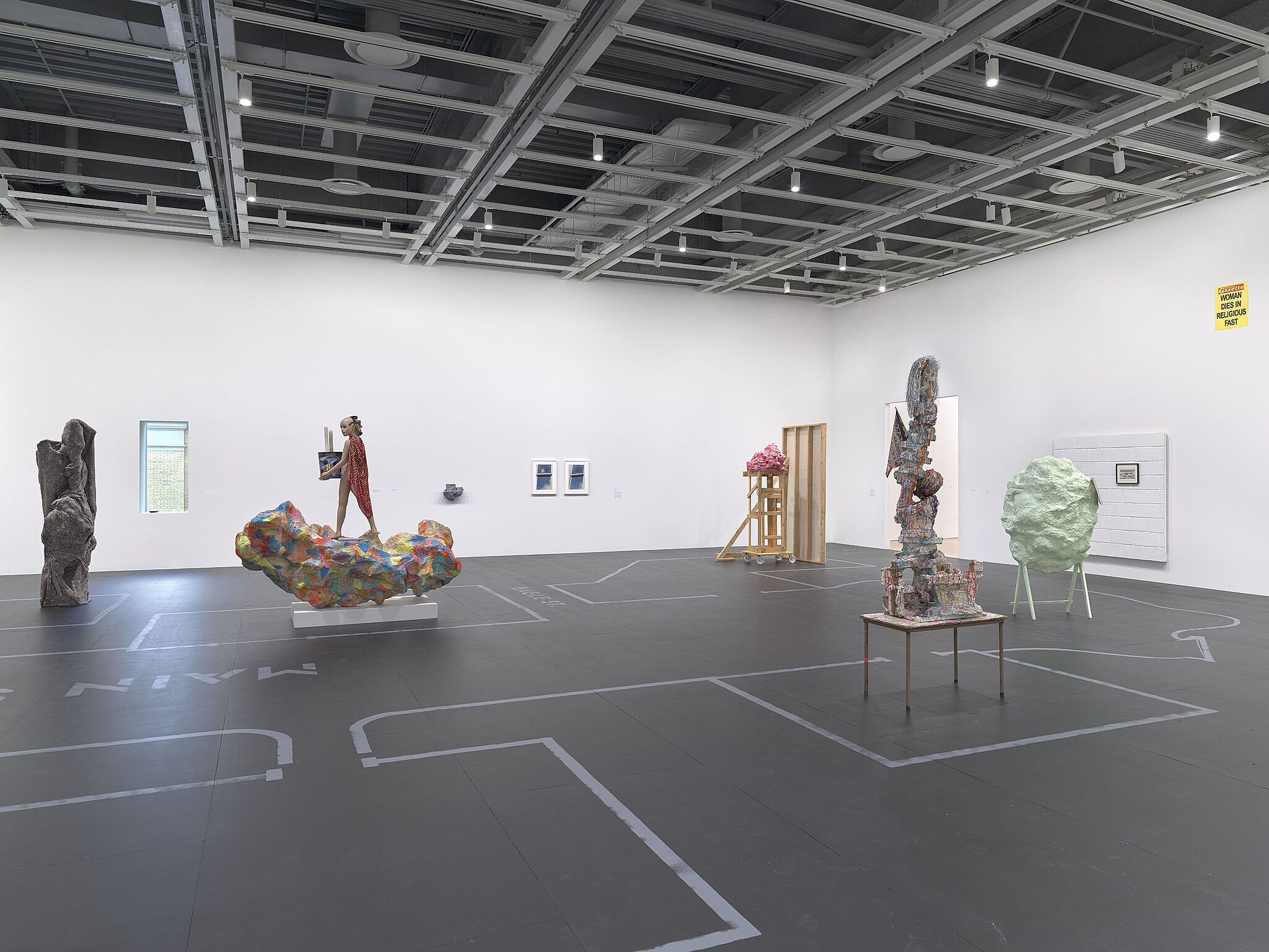 An image of the Whitney galleries with various sculptures.