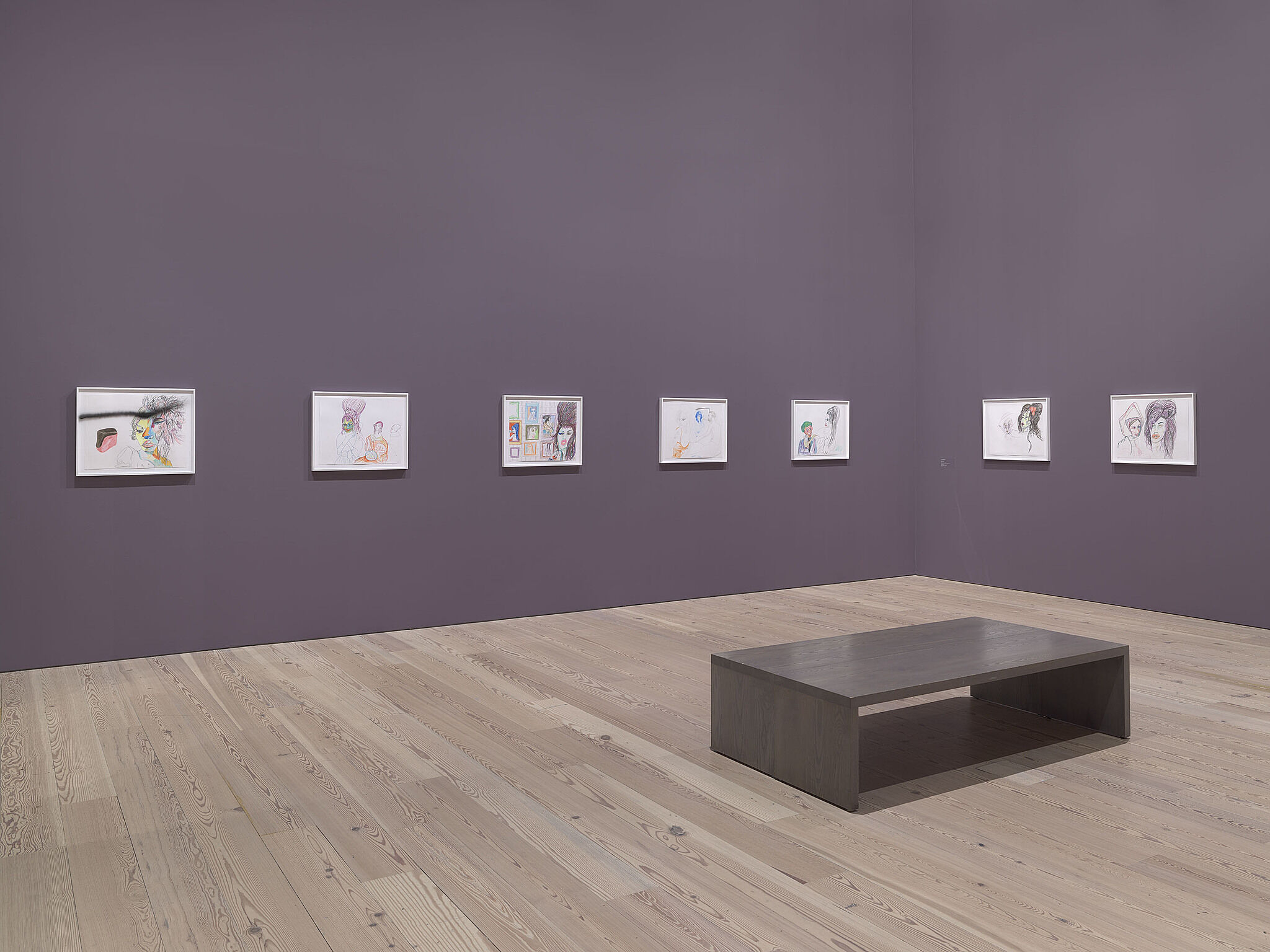 An image of the Whitney galleries with various artworks on the wall.