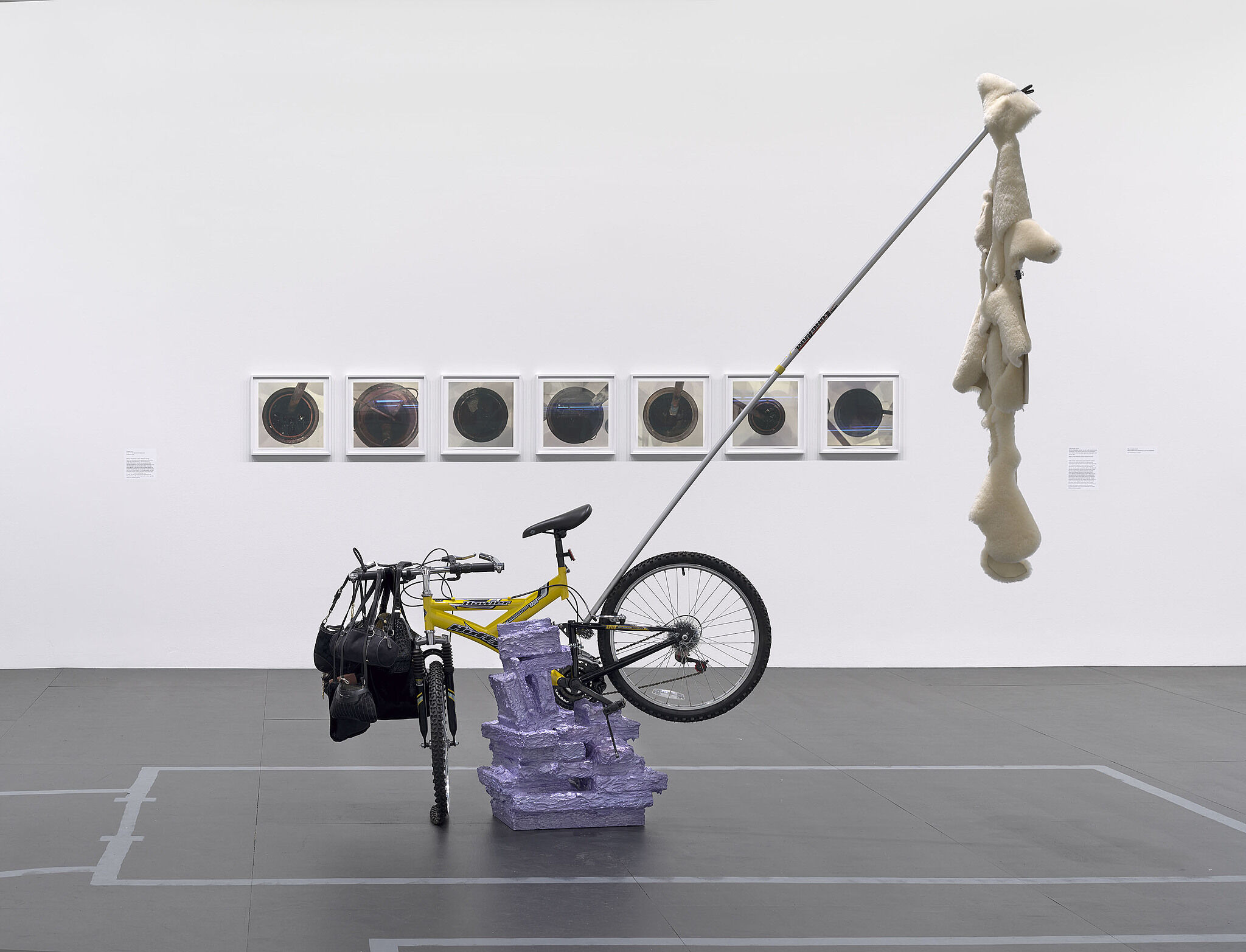 A sculpture made of a bike, pelt, and photograph.