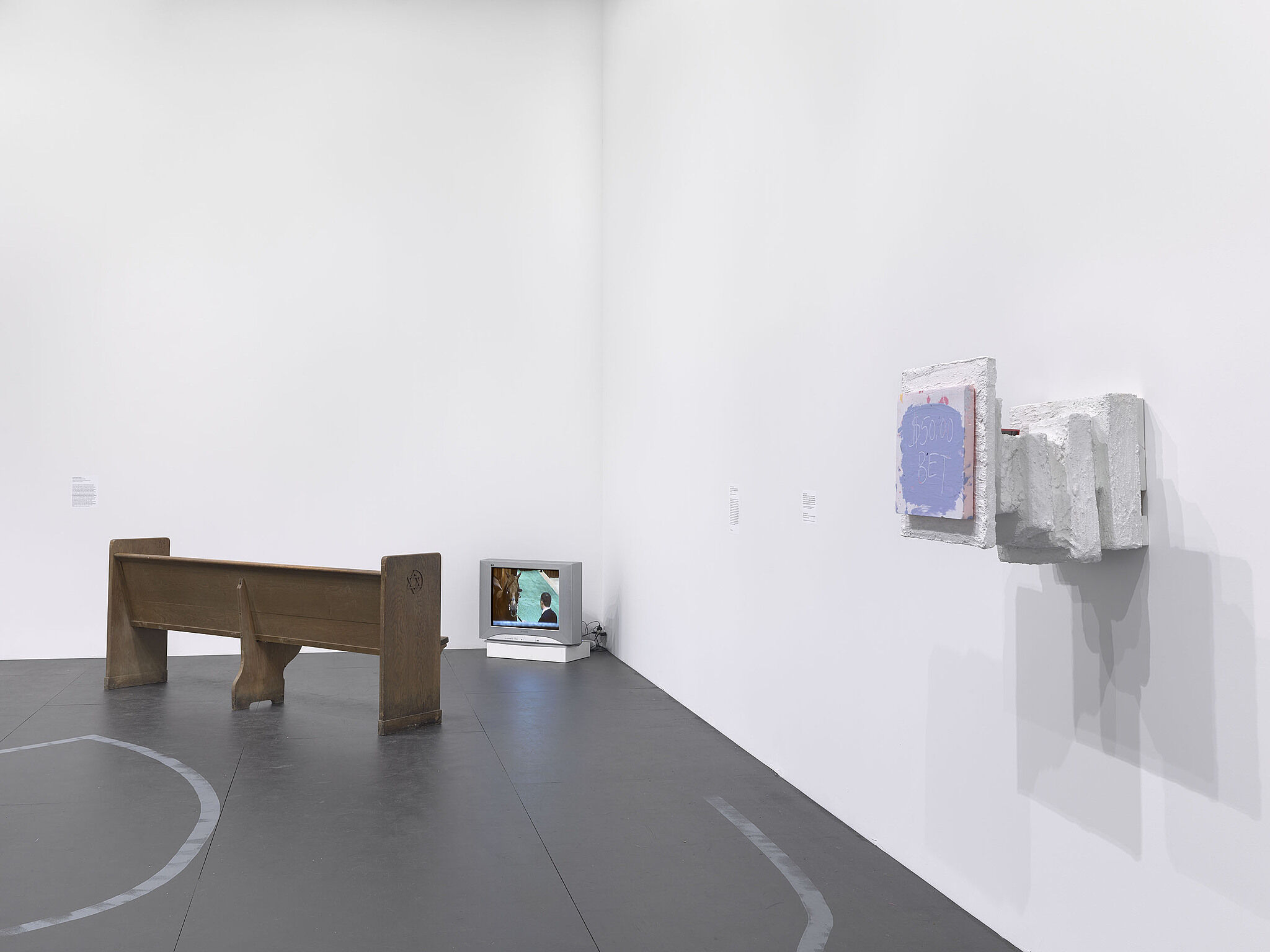 An image of the Whitney galleries with various sculptures and artworks on the walls.
