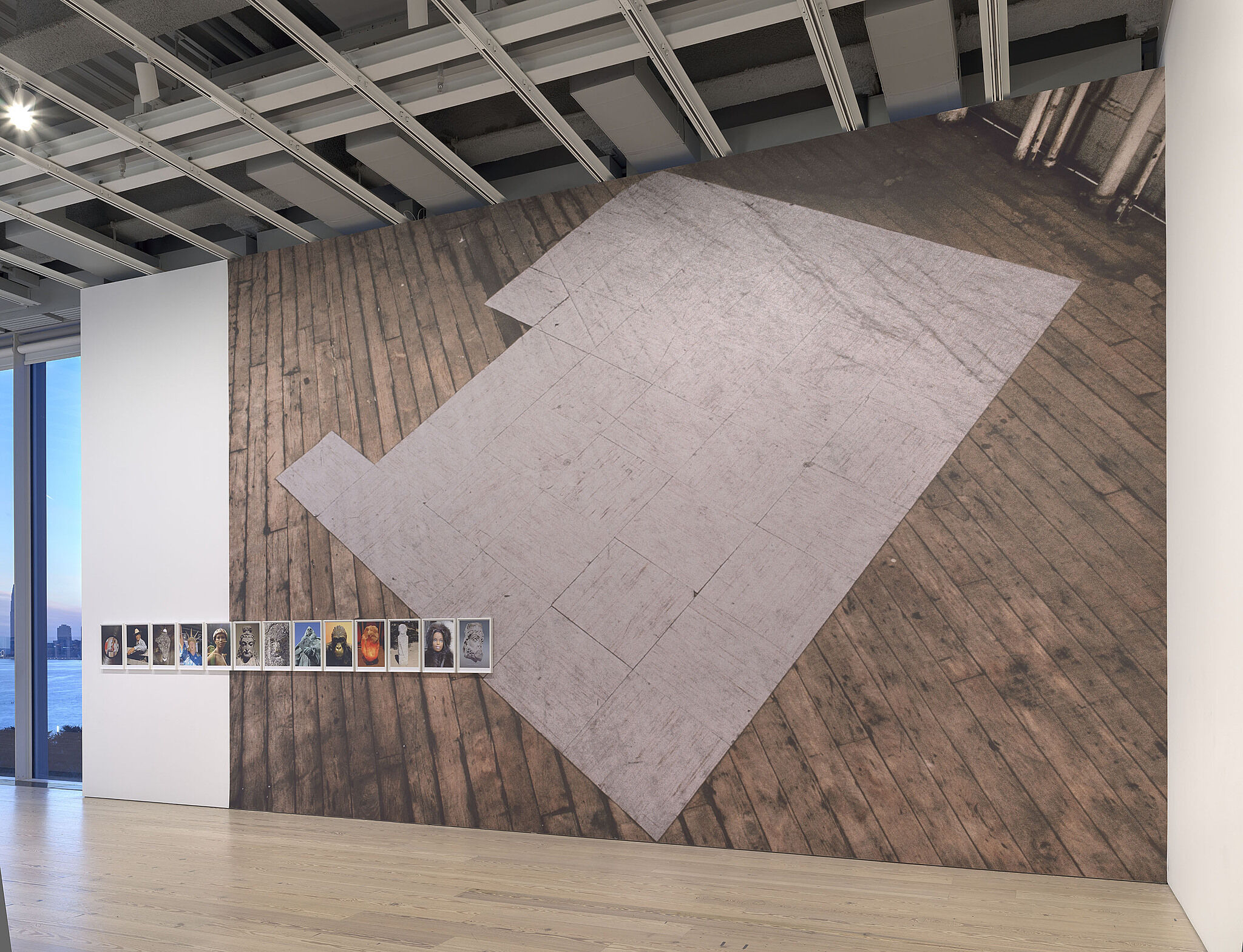 A large photo of wood flooring on a gallery wall.