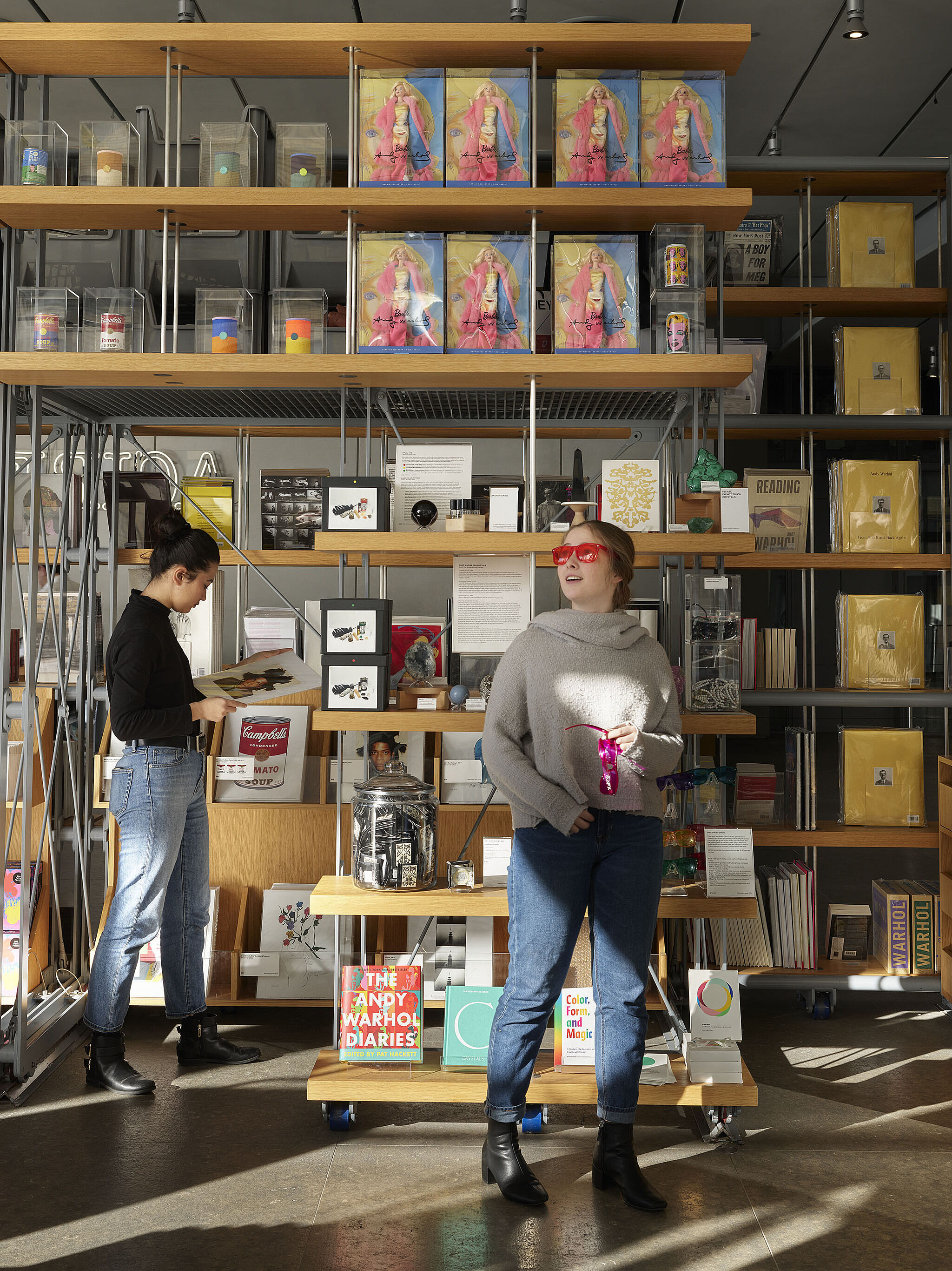 Two people look at items in the Museum Shop.