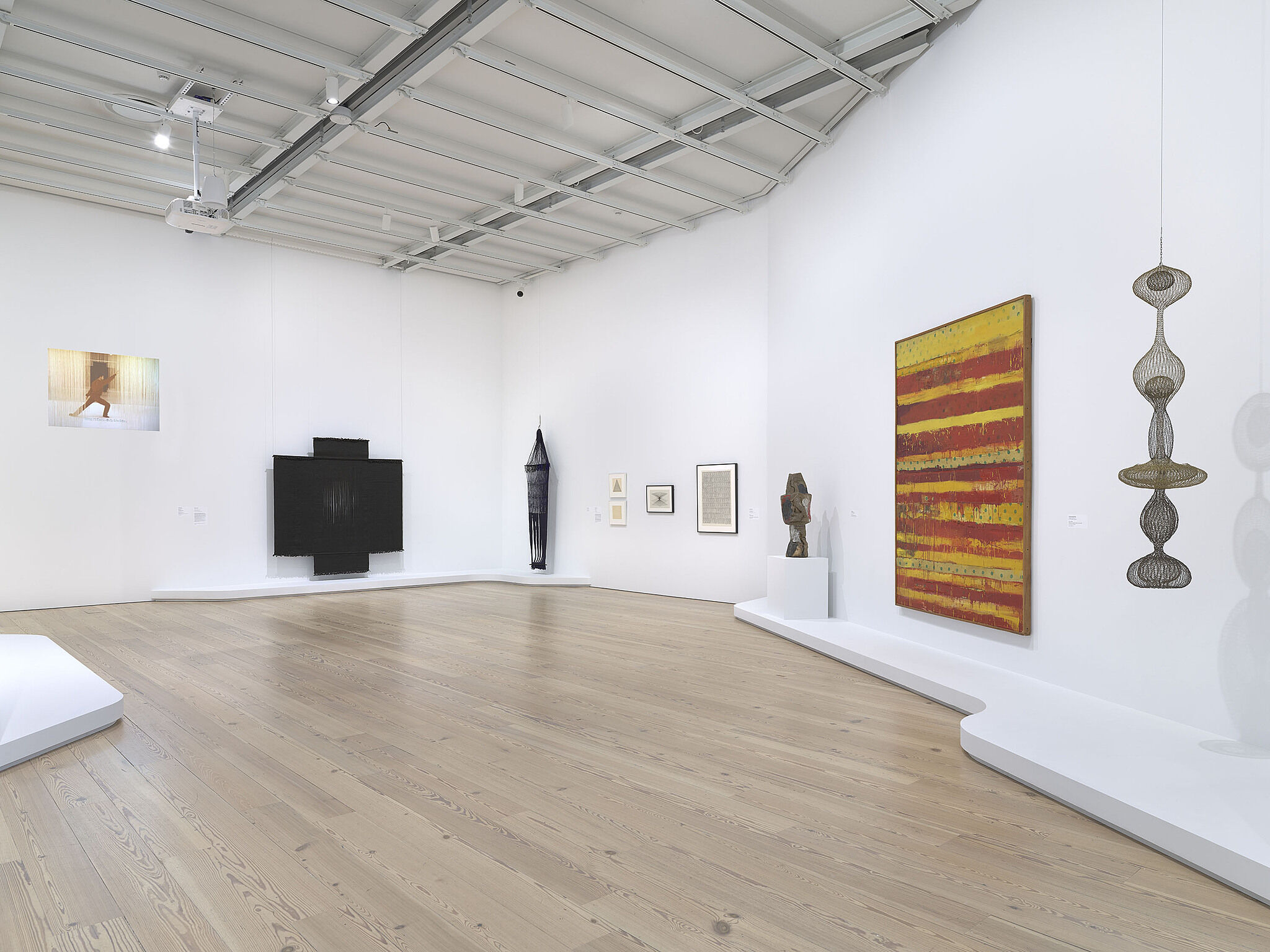 A photo of a Whitney gallery with various artworks.
