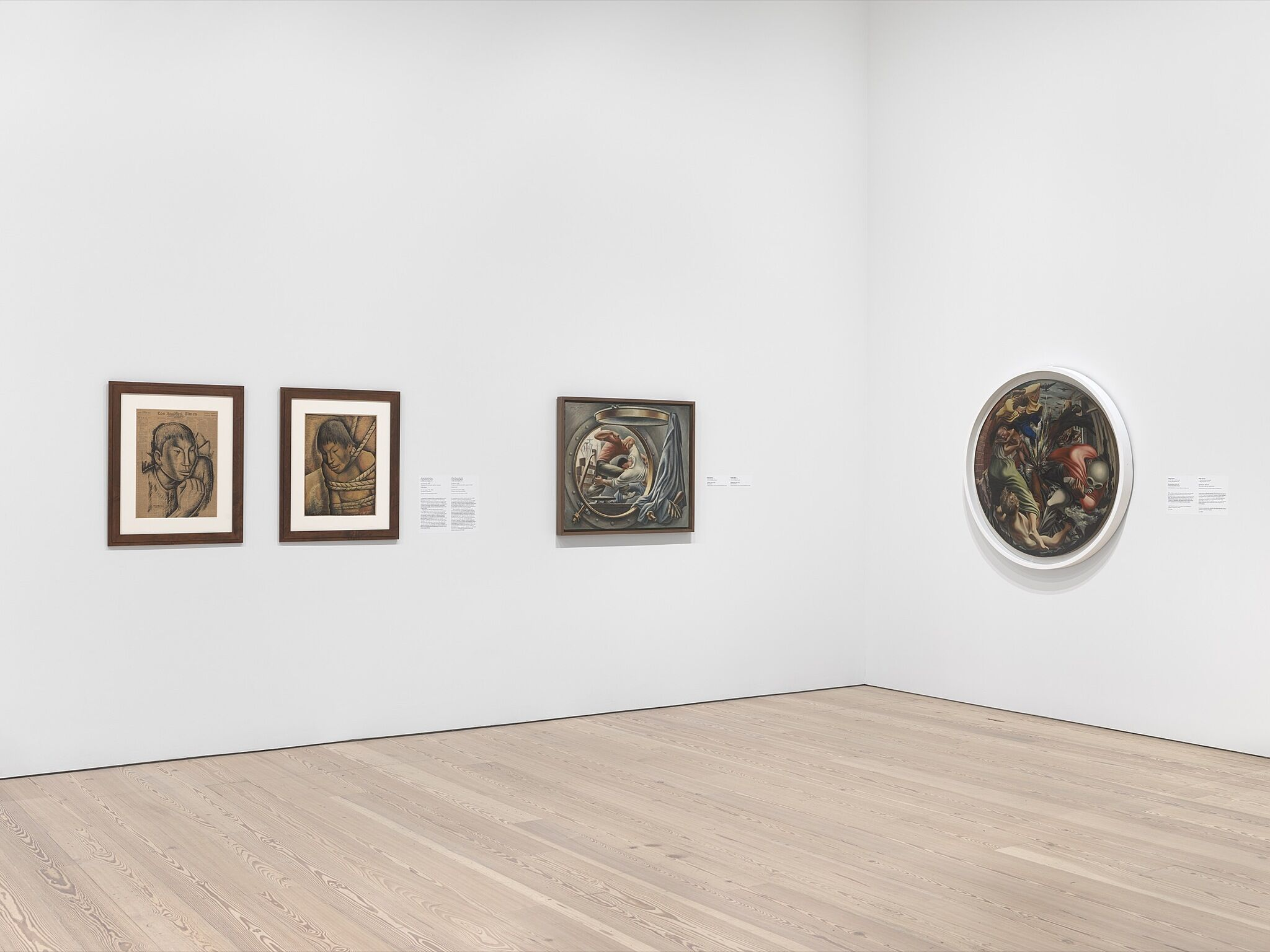 An installation photograph of a gallery with four medium-sized paintings.