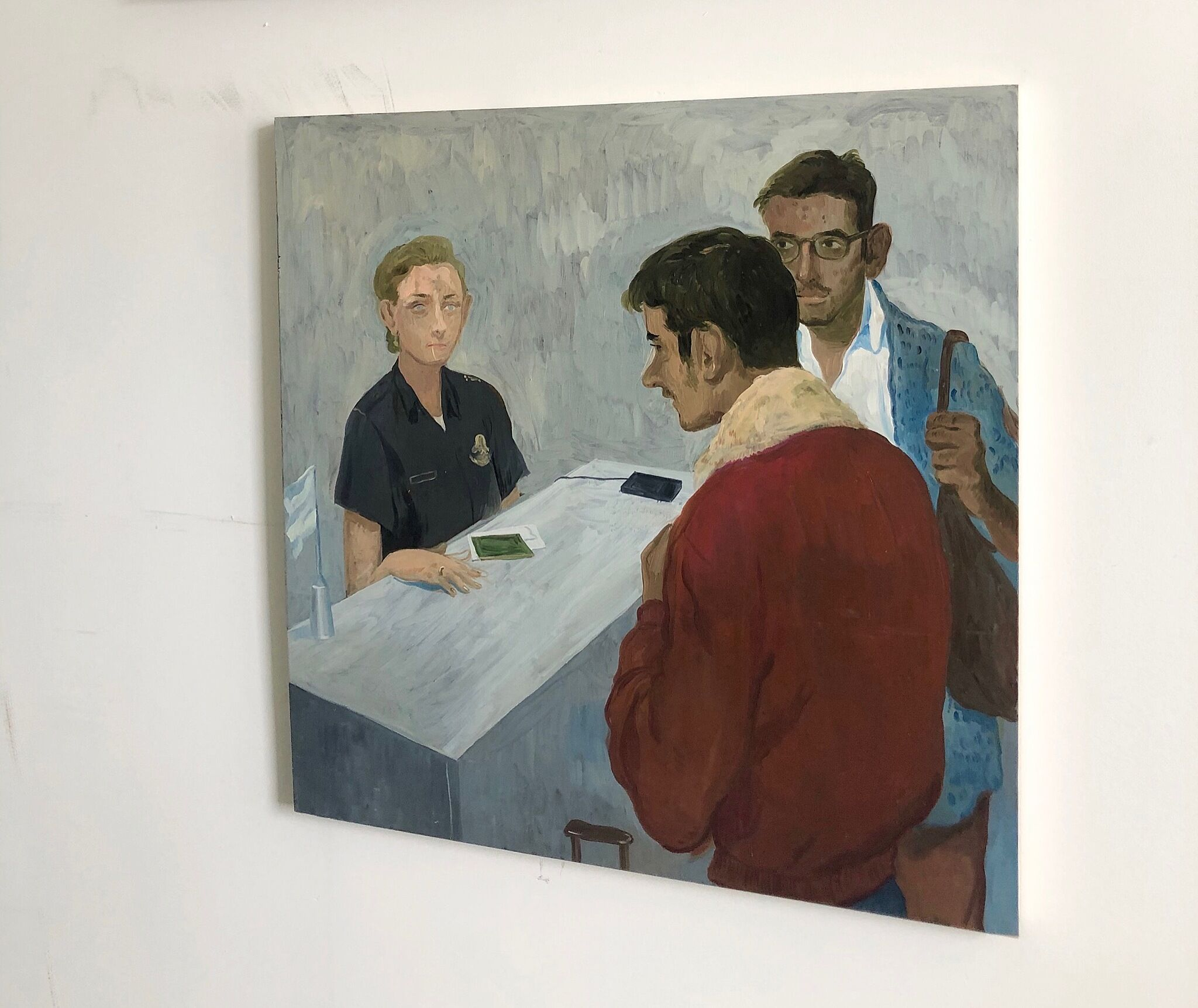 A painting on a wall depicting three individuals around a table charging phones.