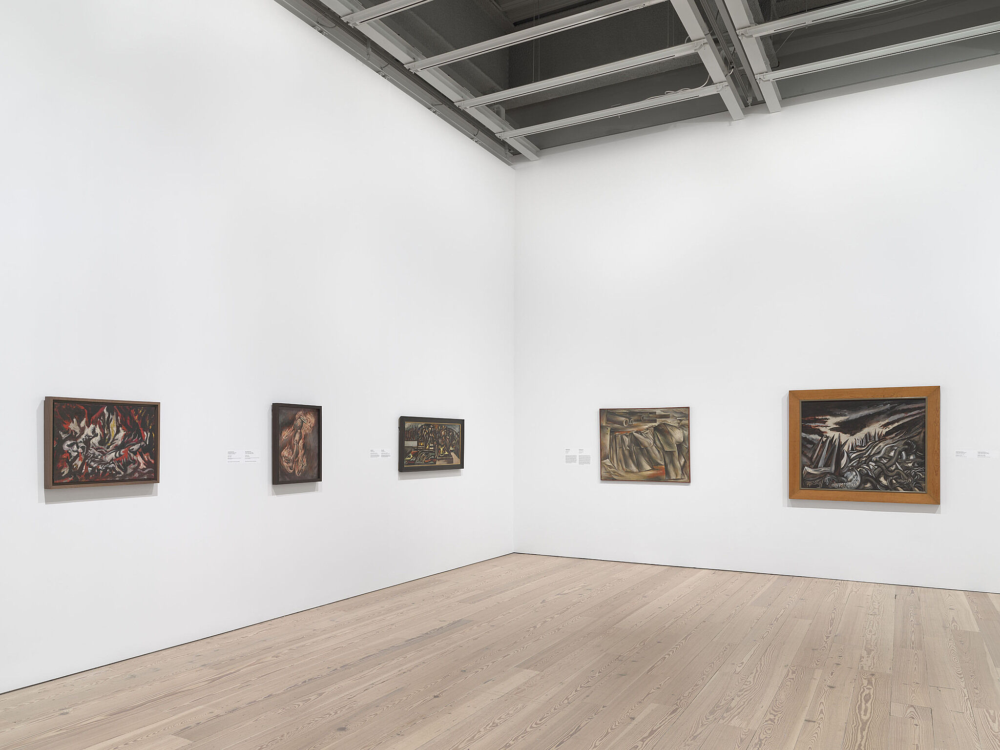 A photo of the Whitney galleries with paintings on the walls.
