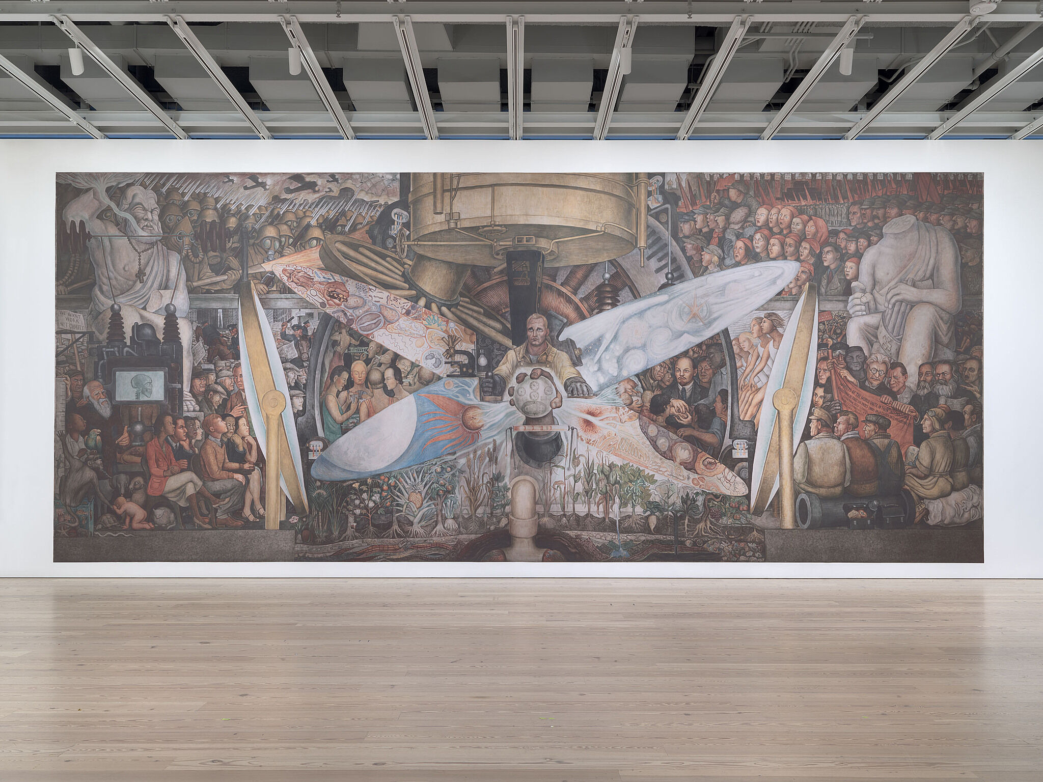 A photo of the Whitney galleries with a large mural reproduction on the wall.