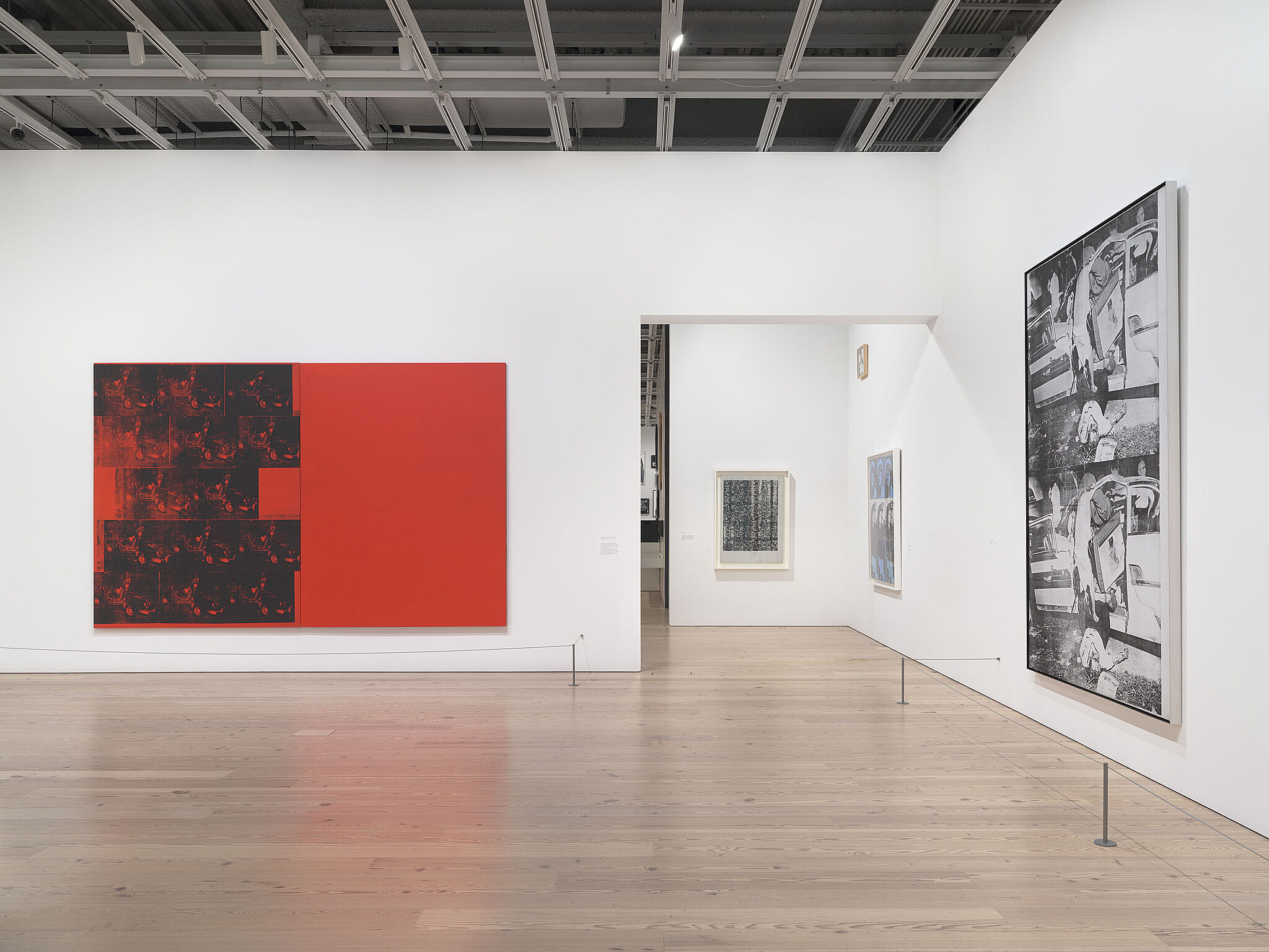 A photo of the Whitney galleries with various prints.