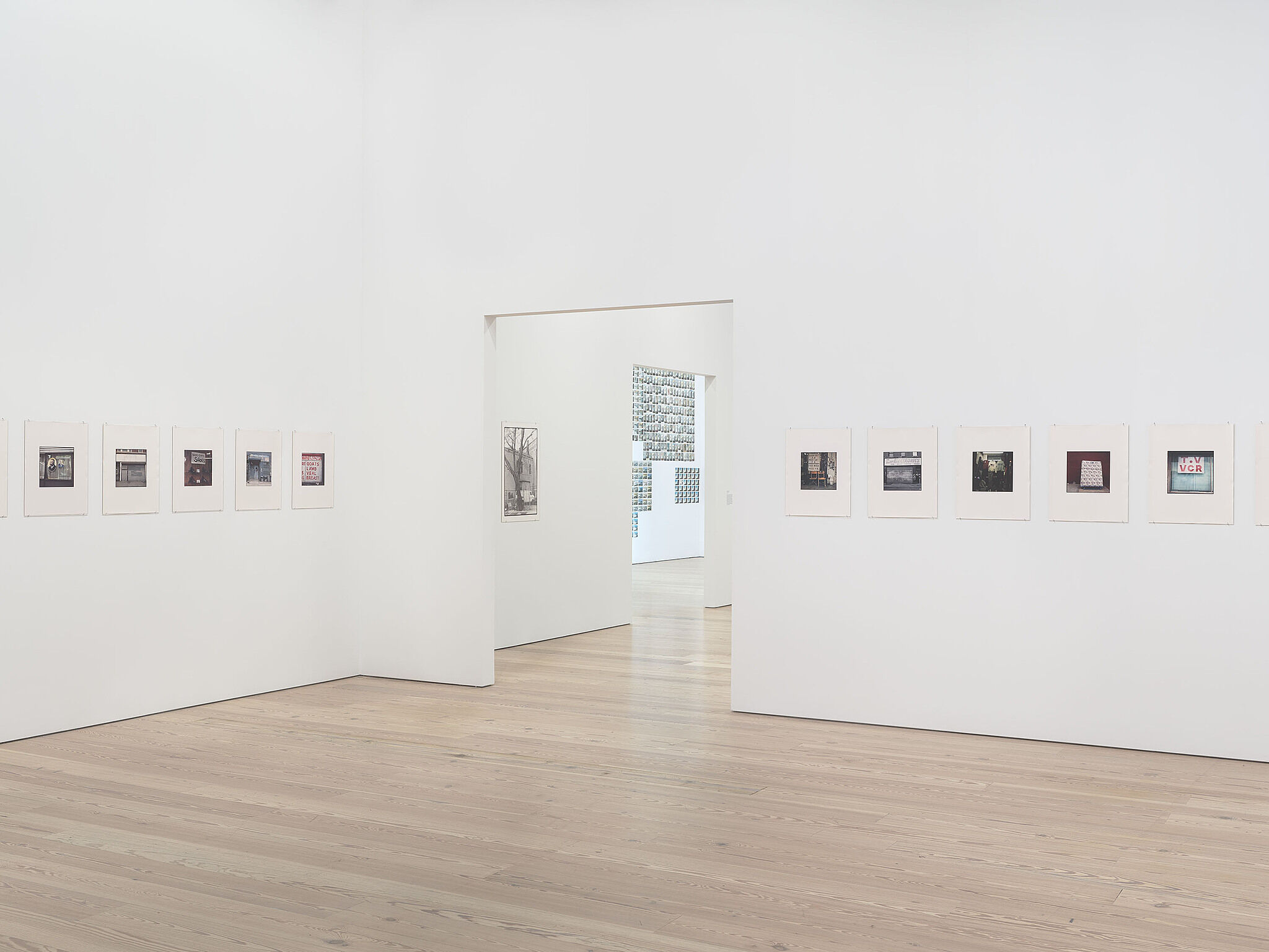 A photo of the Whitney galleries with various photos on the walls.