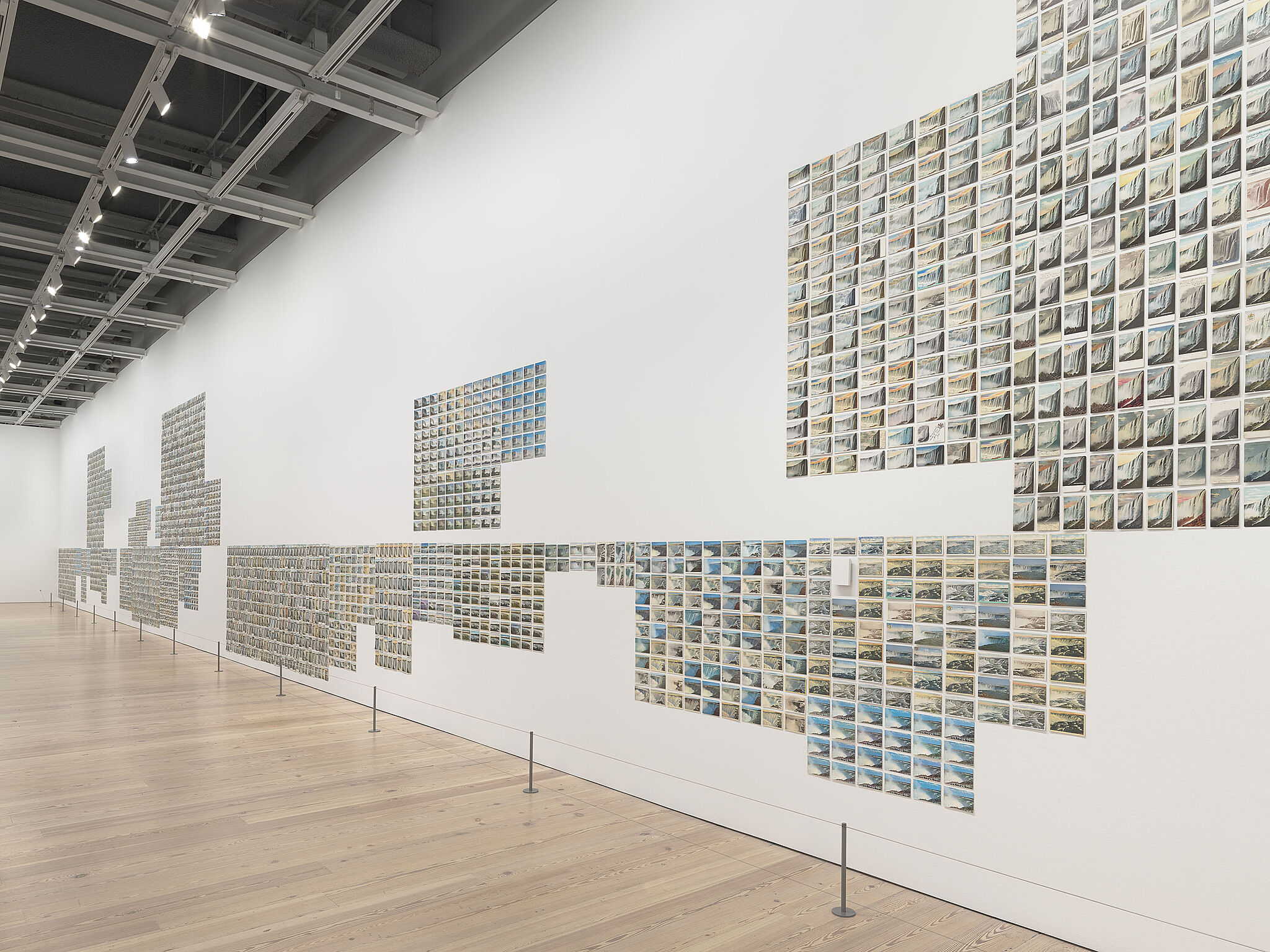 A gallery wall covered with postcards.