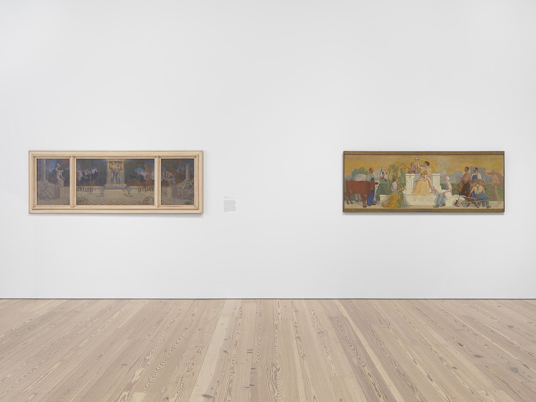 Two paintings on a gallery wall.
