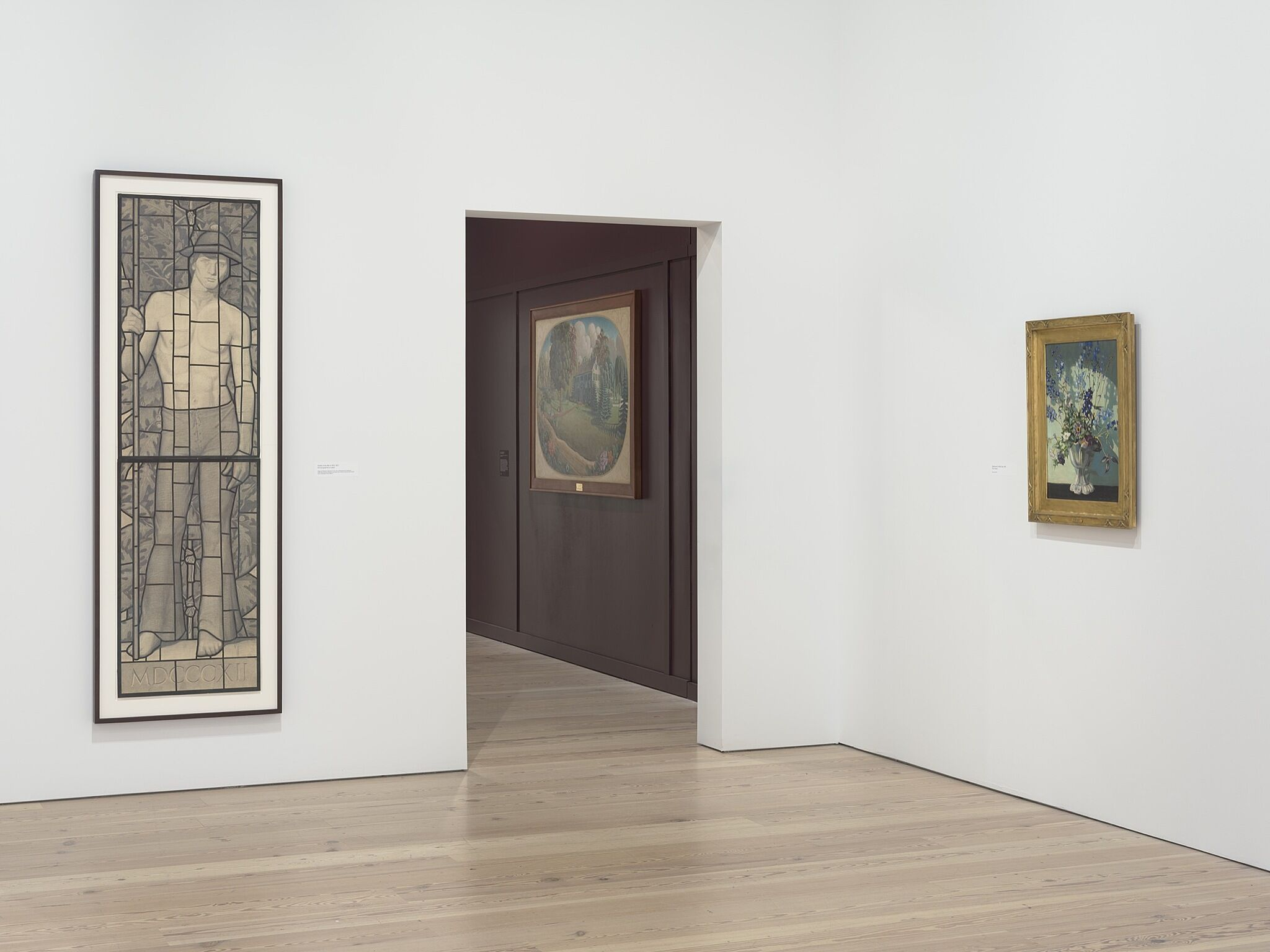 Three paintings in a white gallery space.