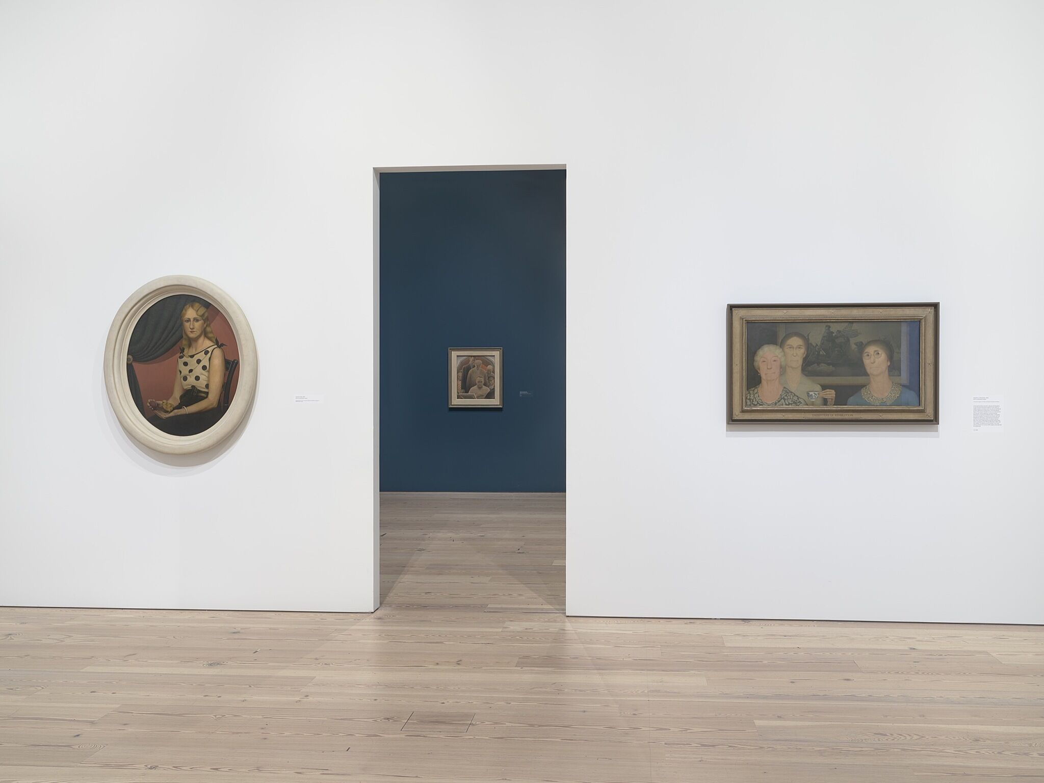 Three paintings in a gallery space.