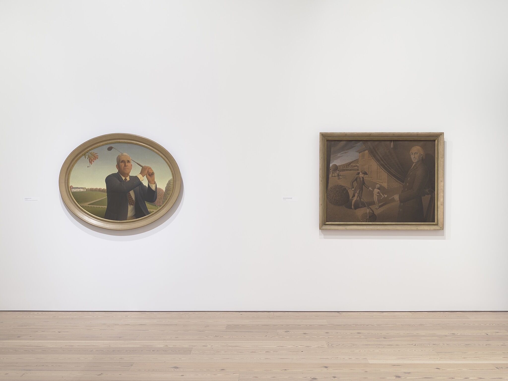 Two paintings on a white wall.