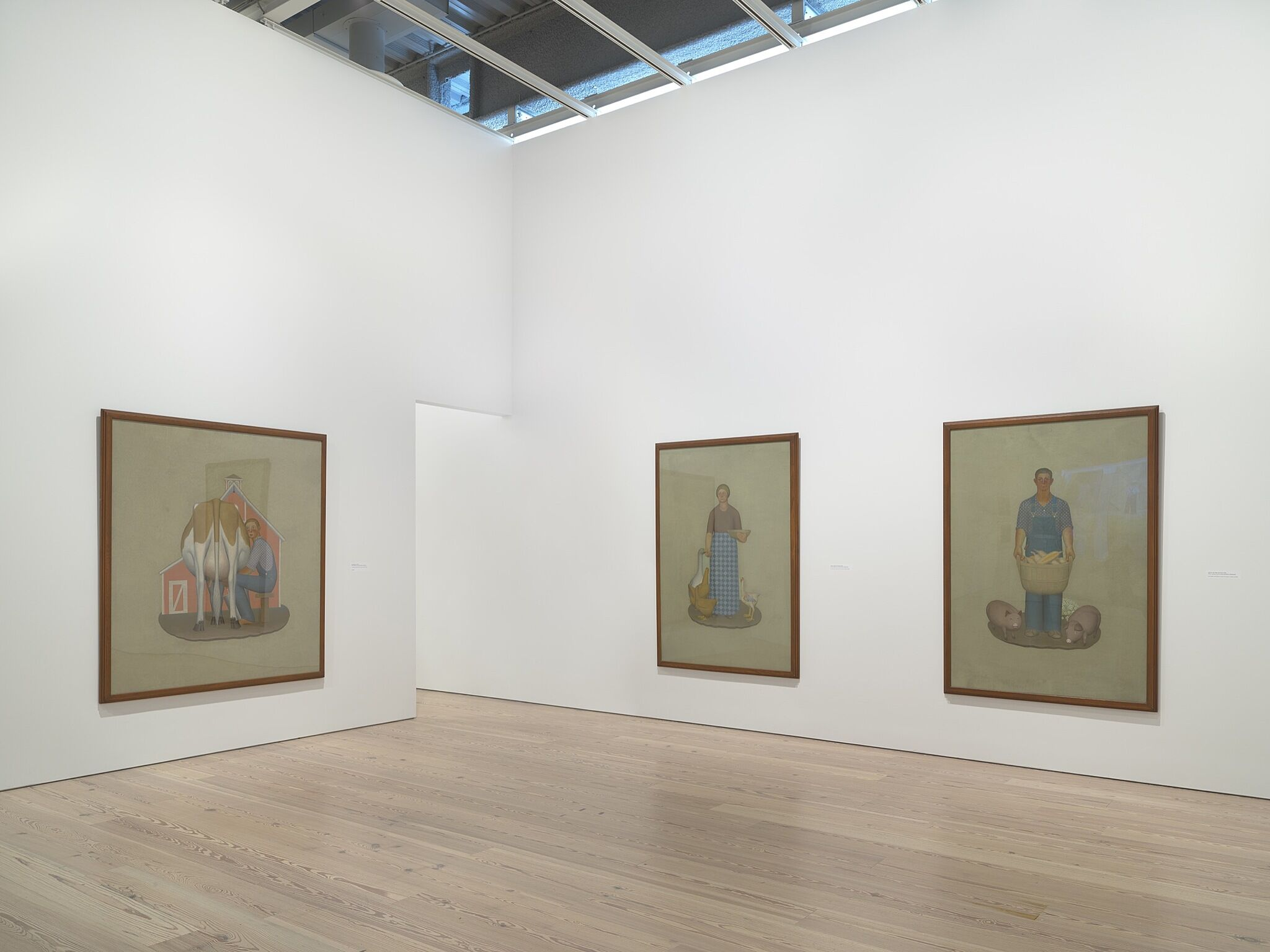 Three large paintings on white gallery walls.