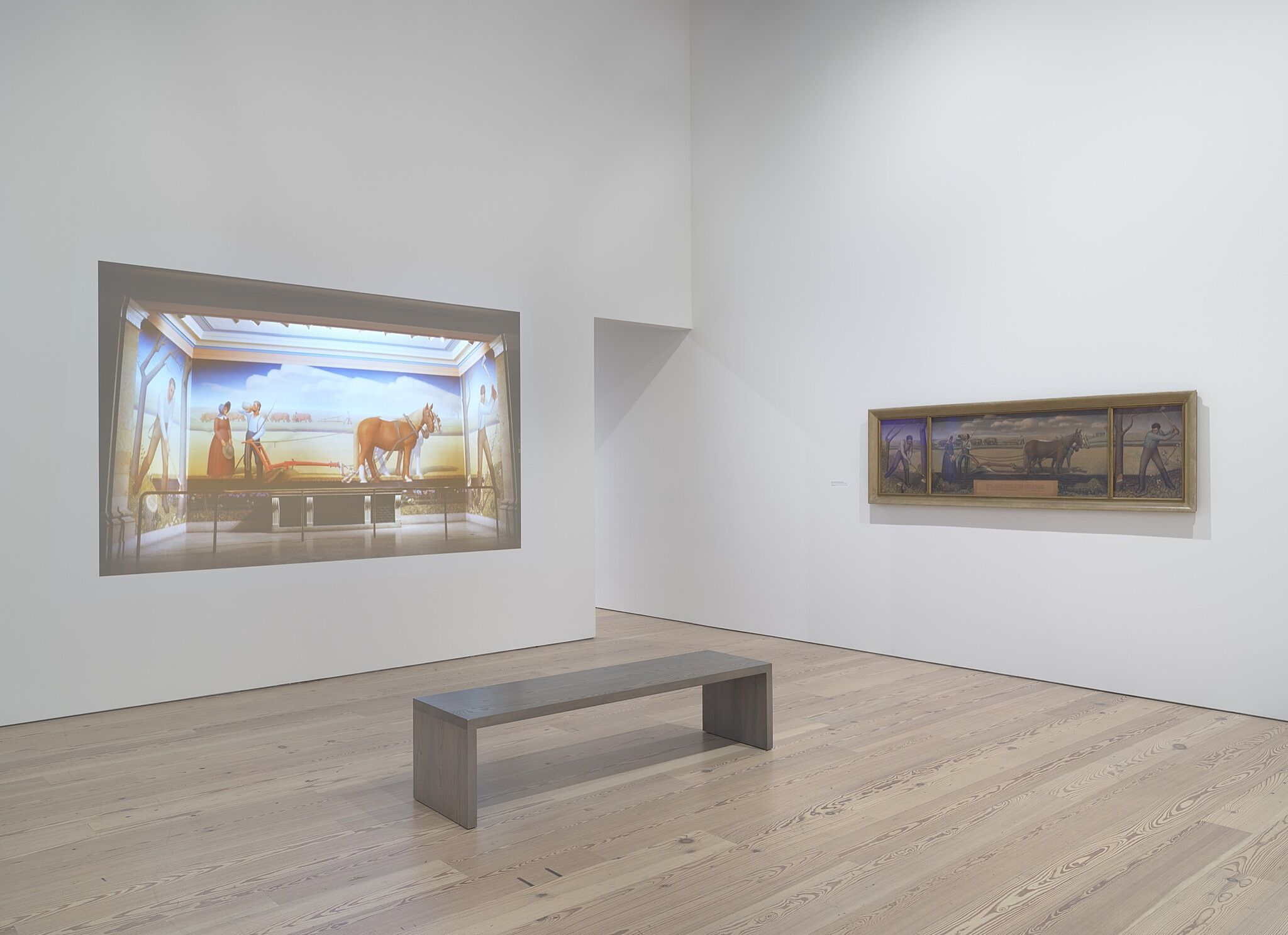 A painting and a video projection in a gallery.