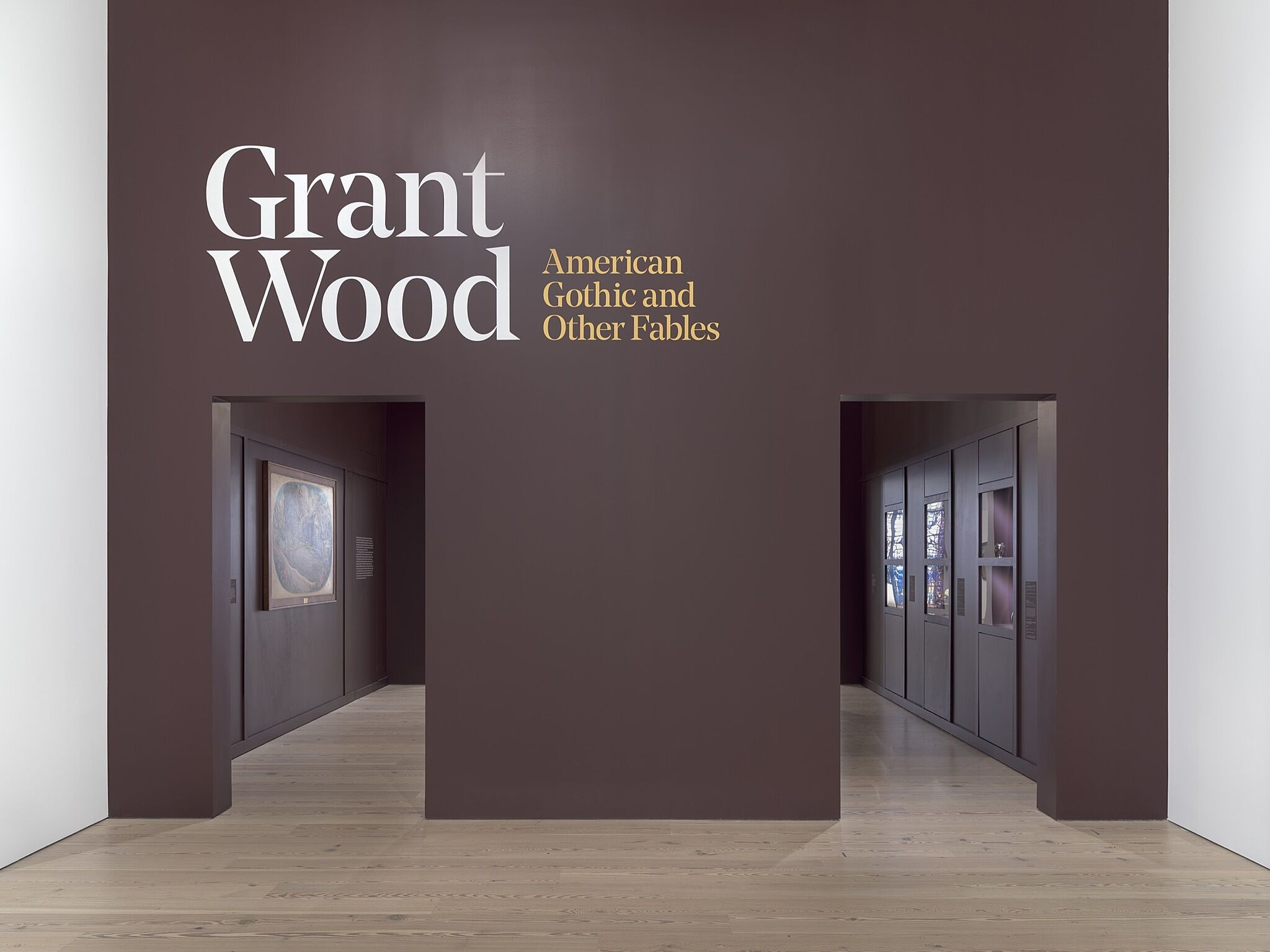The opening of an exhibition with introductory wall text.