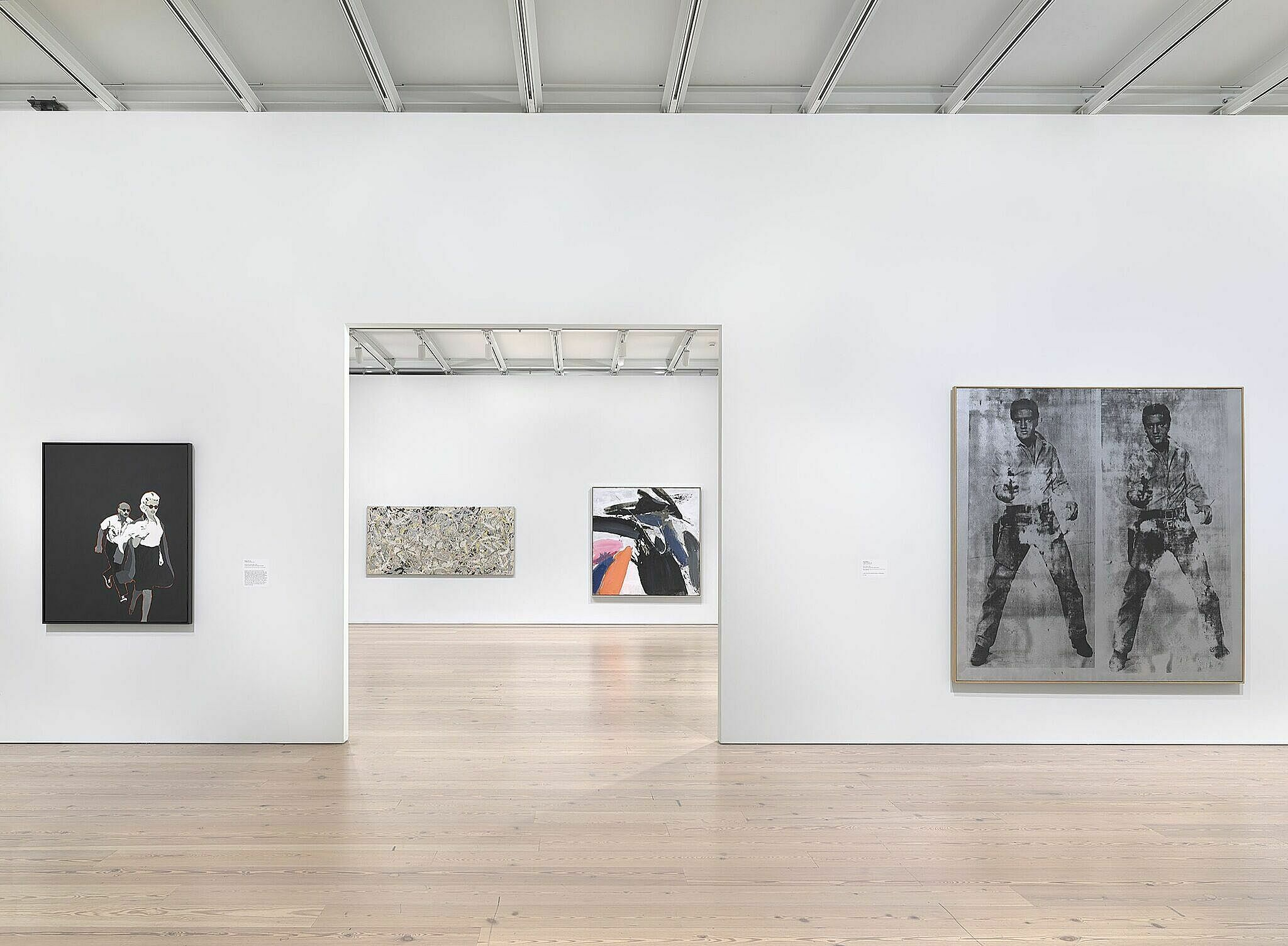 Art on the gallery walls of the Whitney Museum of American Art, including Warhol's Double Elvis, all against white walls.