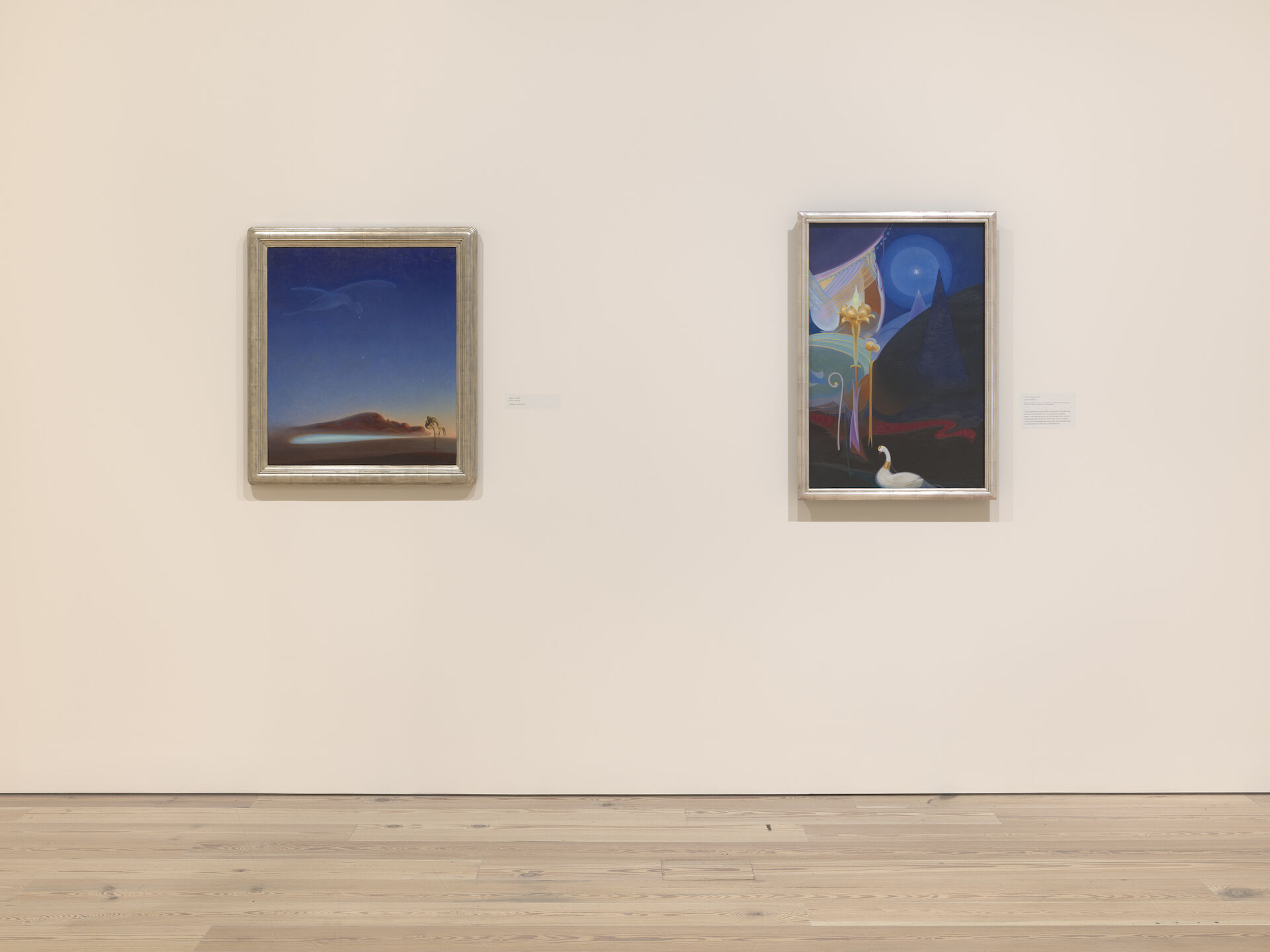 Return, 1940; and Ahmi in Egypt, 1931 by Agnes Pelton appear on a white wall at the Whitney Museum of American Art.