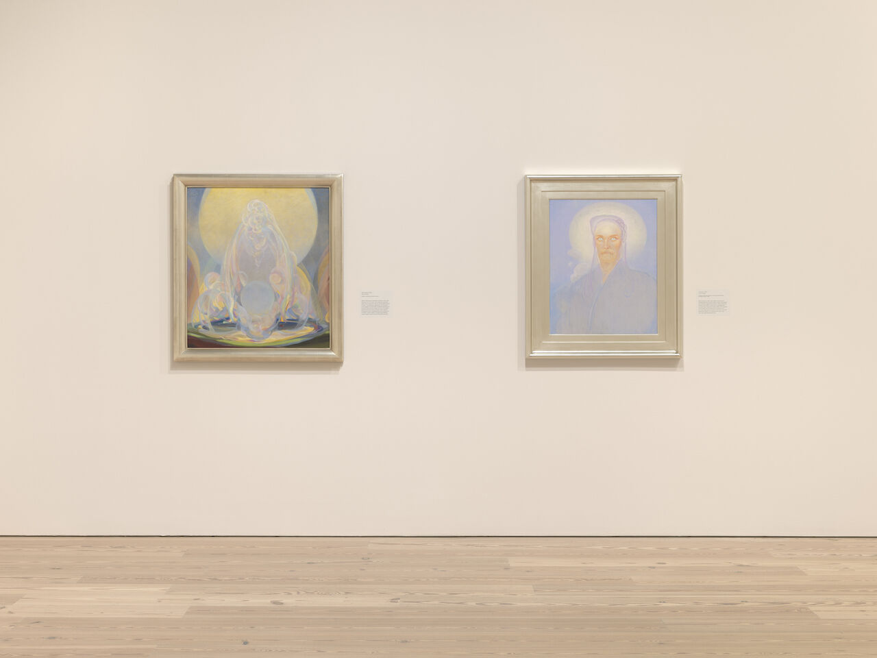 Two paintings by Agnes Pelton are directly in view a few feet away on a white wall at the Whitney. The paintings from left to right are The Fountains, 1926 and Intimation, 1933.