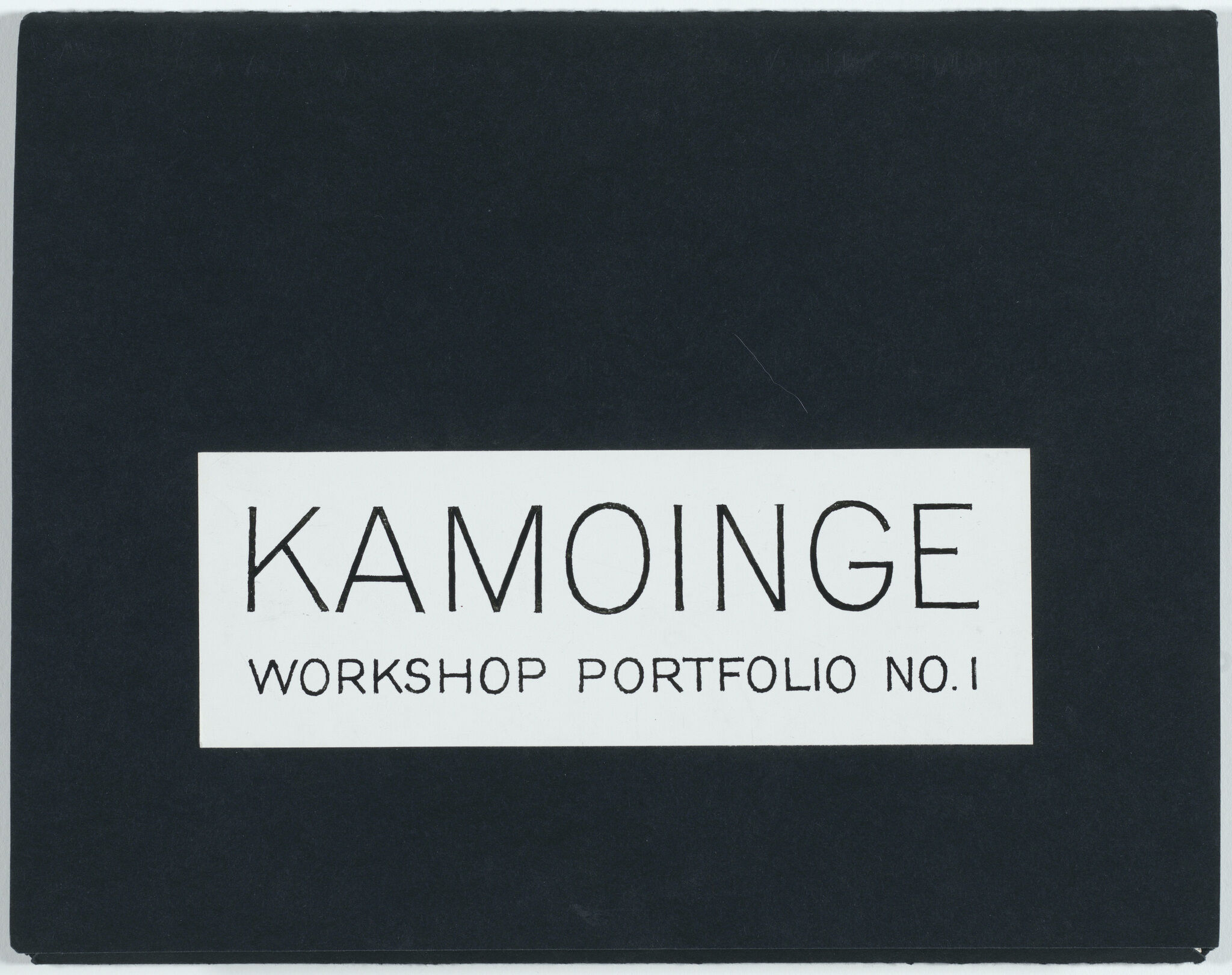"A portfolio cover that reads ""Kamoinge Workshop Portfolio No. 1""."