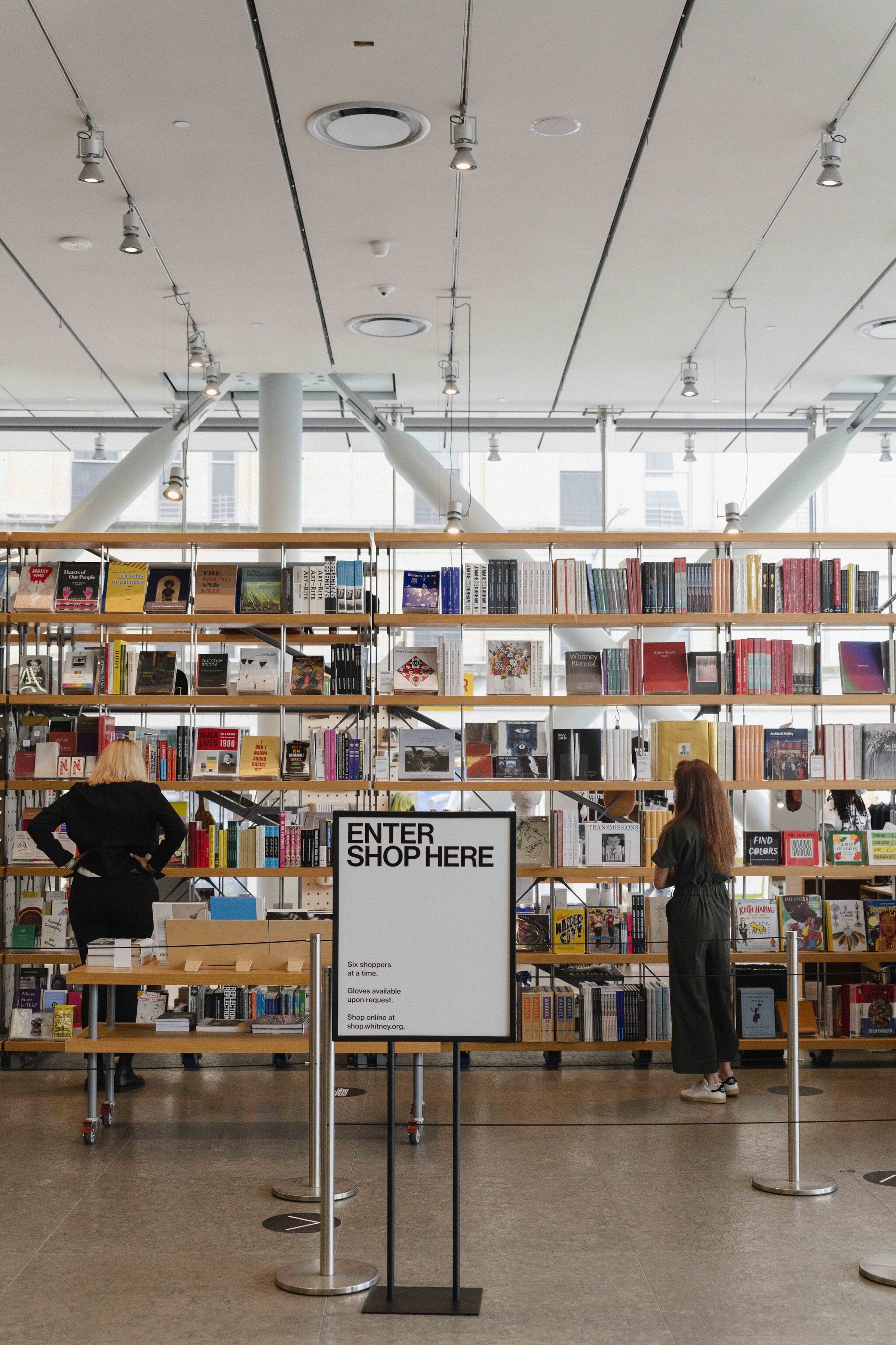 Visitors explore the book selection at the Whitney shop