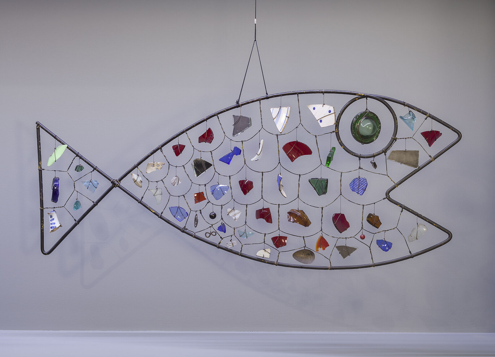 A sculpture of a fish made out of metal and wire.