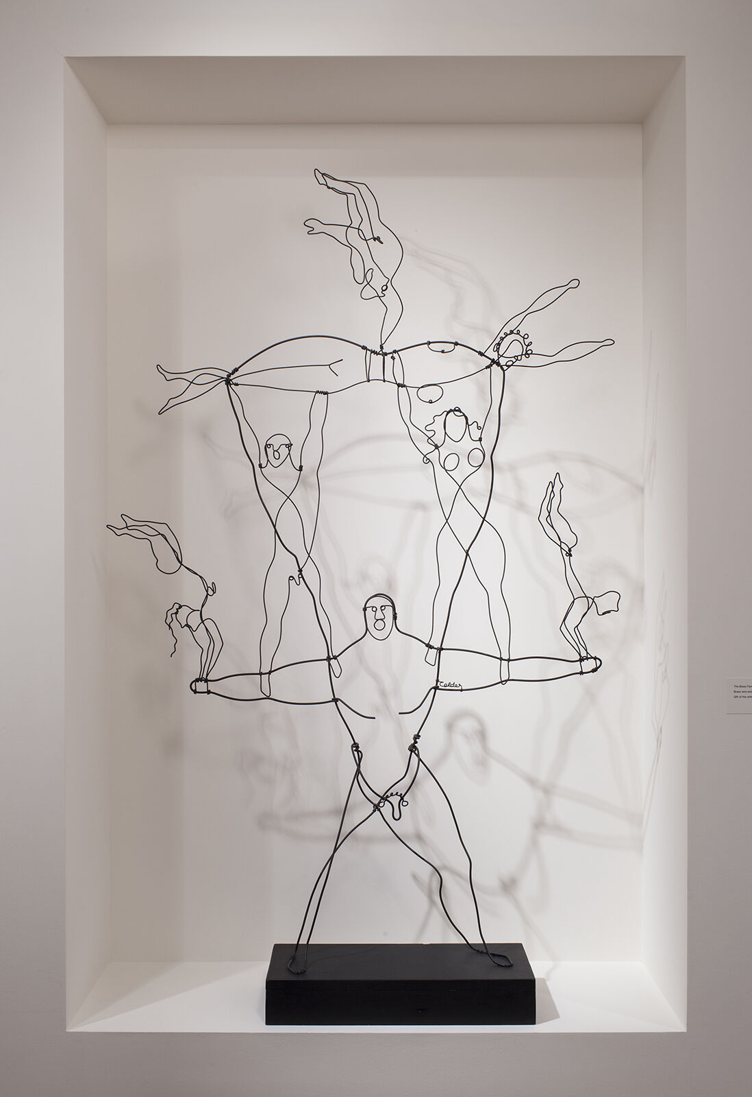 A wire sculpture of multiple figures.