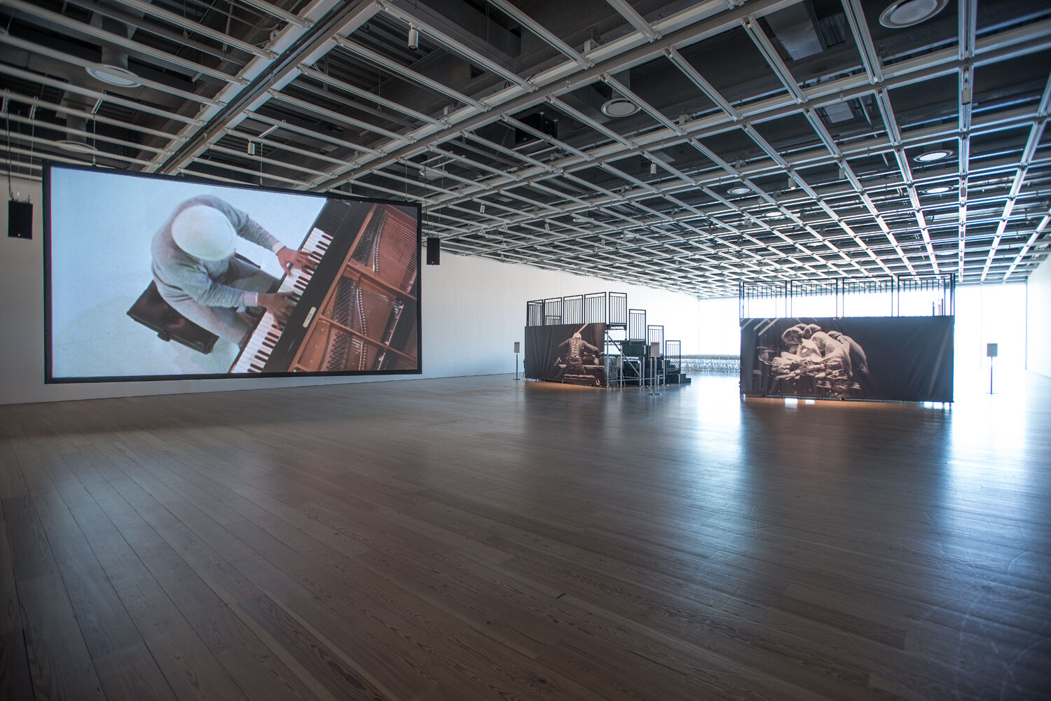 A gallery with a large screen.