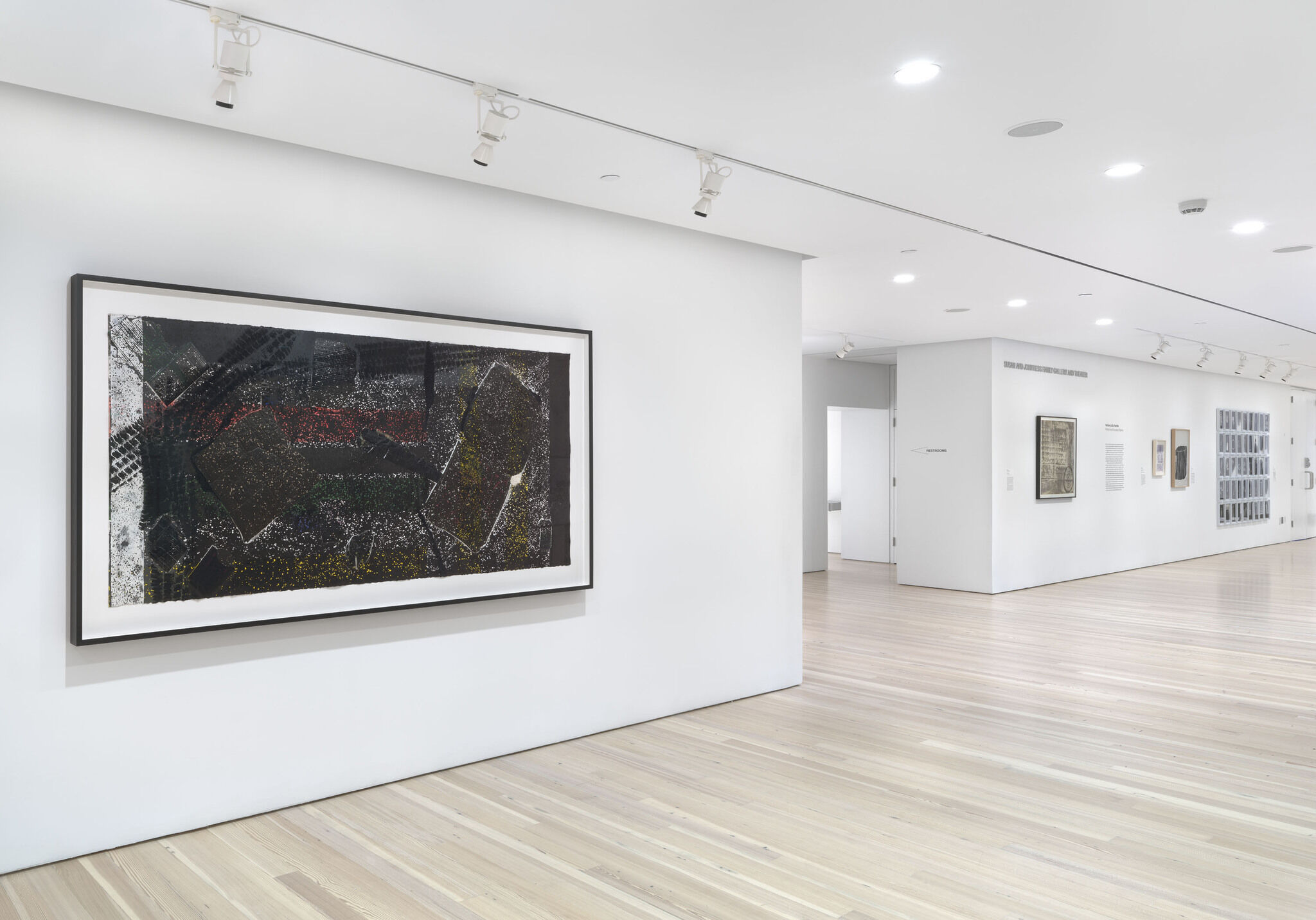 Works of art displayed on white walls in a gallery.