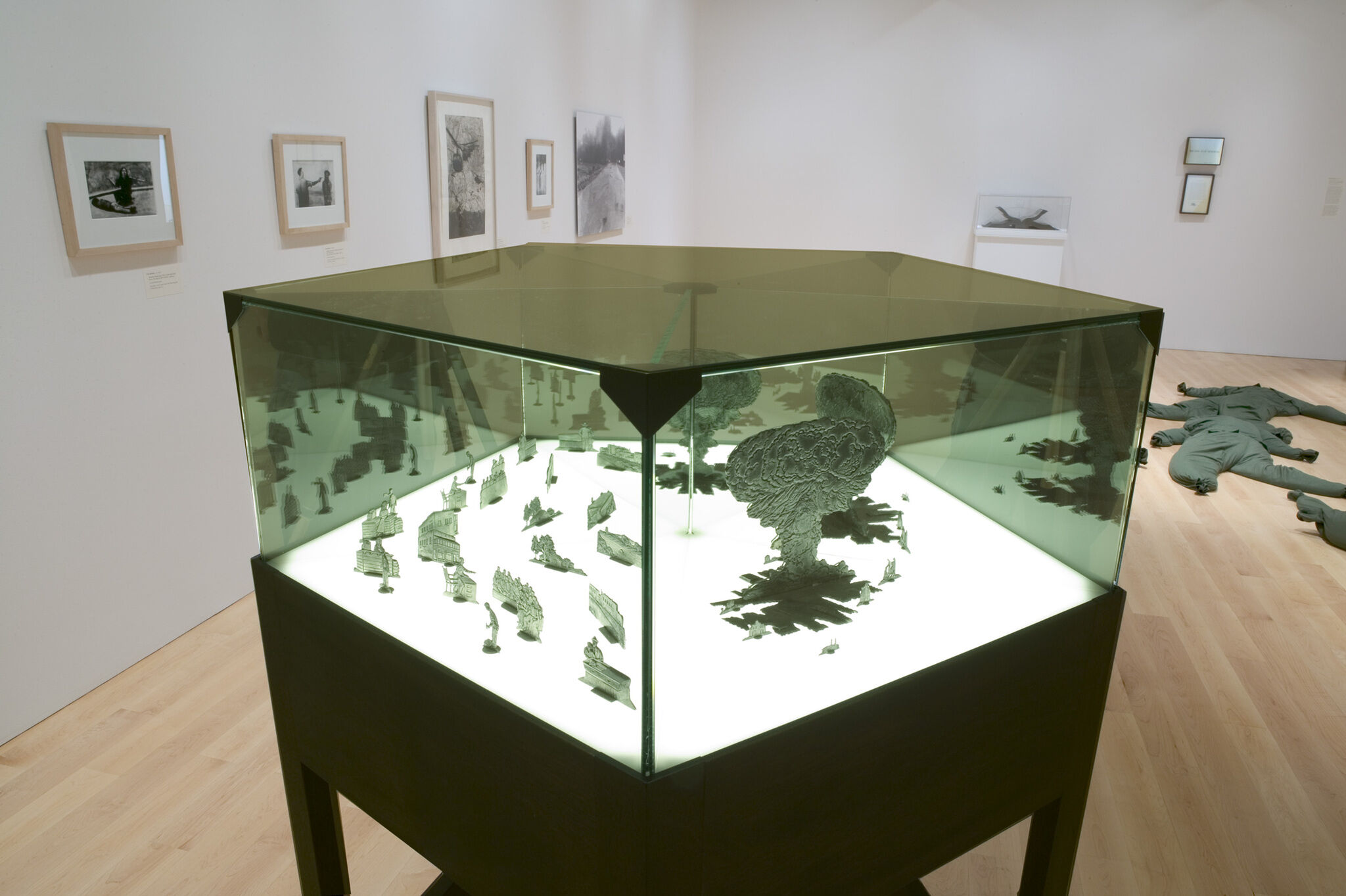 A green tinted glass case in a gallery.