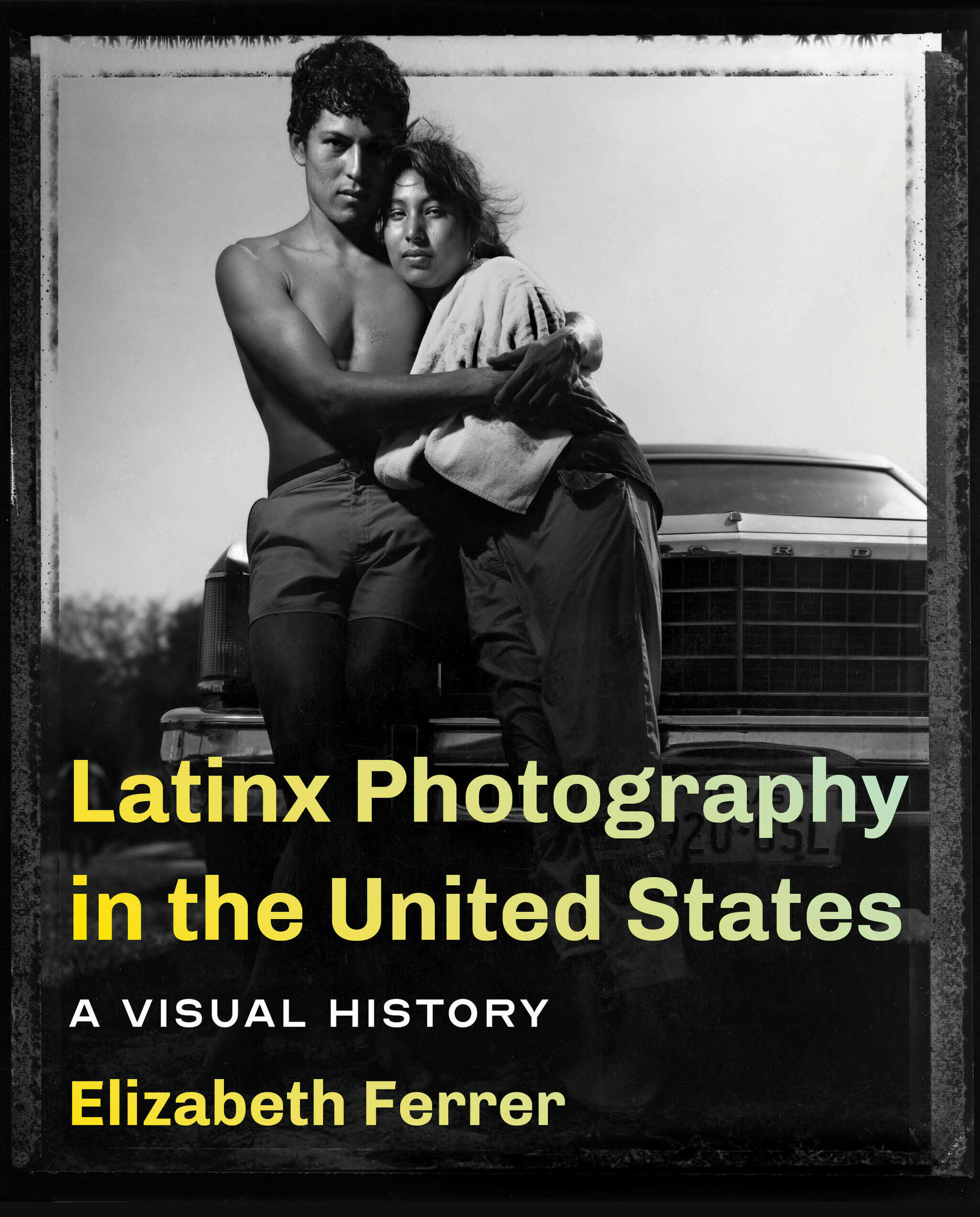 A book cover with two Latinx people leaning against the front of a car.